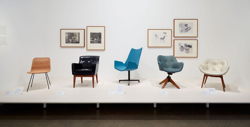 A Cane Metal chair made by E & F Industries from 1954 on the left, the Series 21 chair from 1957 in black vinyl and the Floating chair from 1960 in electric blue. The chair on the swivel base and the white chair (far right) are A310.
