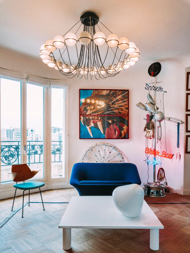 The apartment of Clémence & Didier Krzentowski in Paris is an incredible mix of contemporary limited edition design prototypes, vintage lighting and furniture along with serious art pieces.