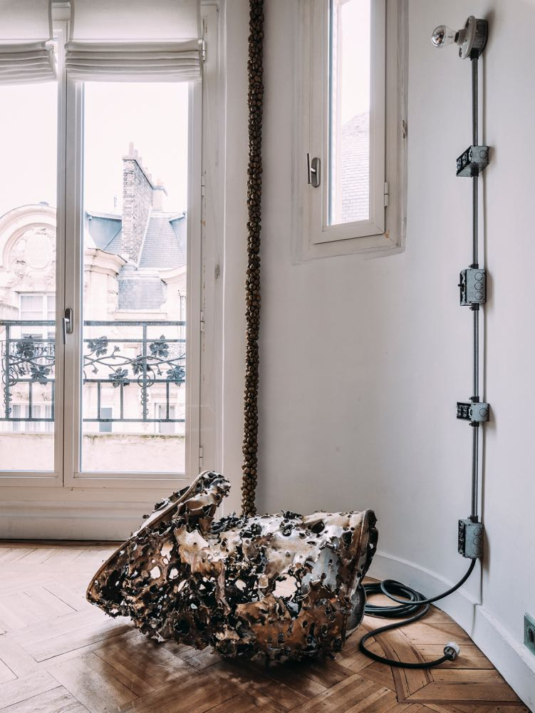 The Paris apartment of the owners of Galerie kreo - Clémence & Didier Krzentowski, with a sculpture by Dahn Vo.