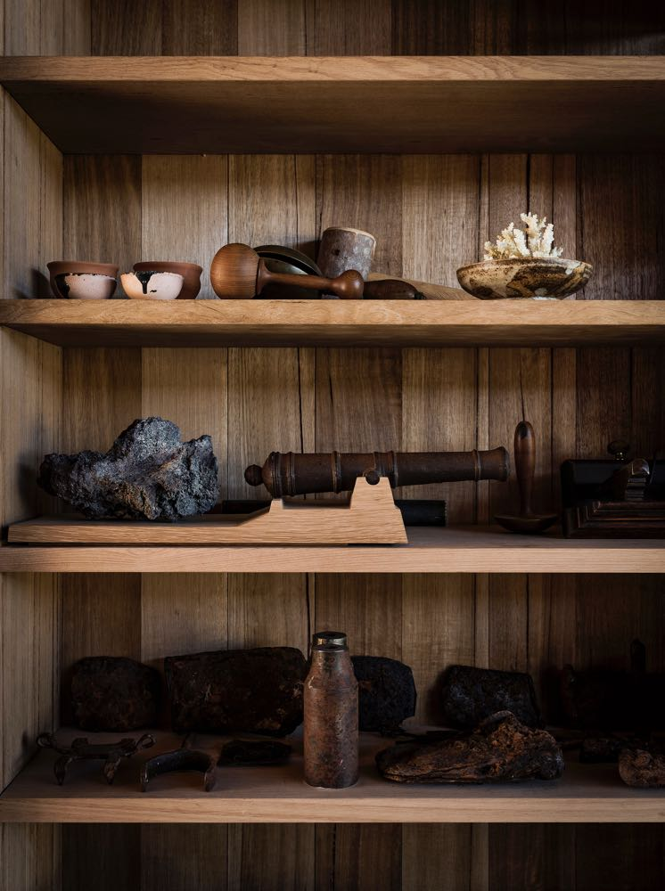 Found objects on shelving in the lounge area of John and Susan Wardle's Bruny Island house in Tasmania, known as Captain Kelly's Cottage.