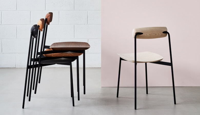 The 'Sia' chair by Tom Fereday for Nau shown stacked on the left in various timber finishes and on the right in natural ash.