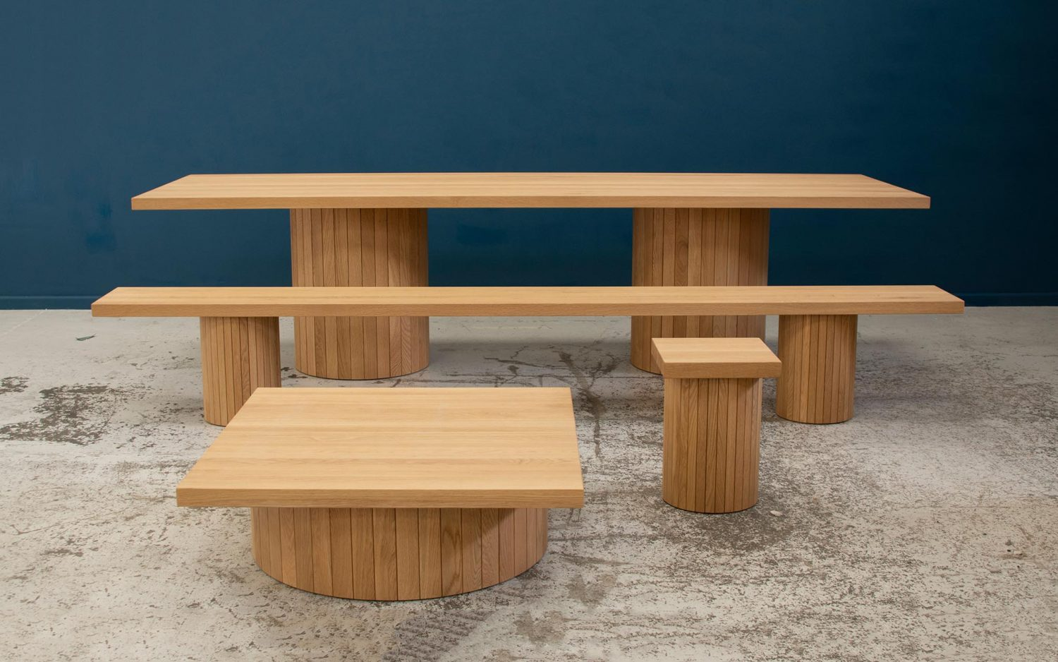 Philippe Malouin's Barrel collection for SCP uses solid oak planks to form barrel-like bases across a range of tables.