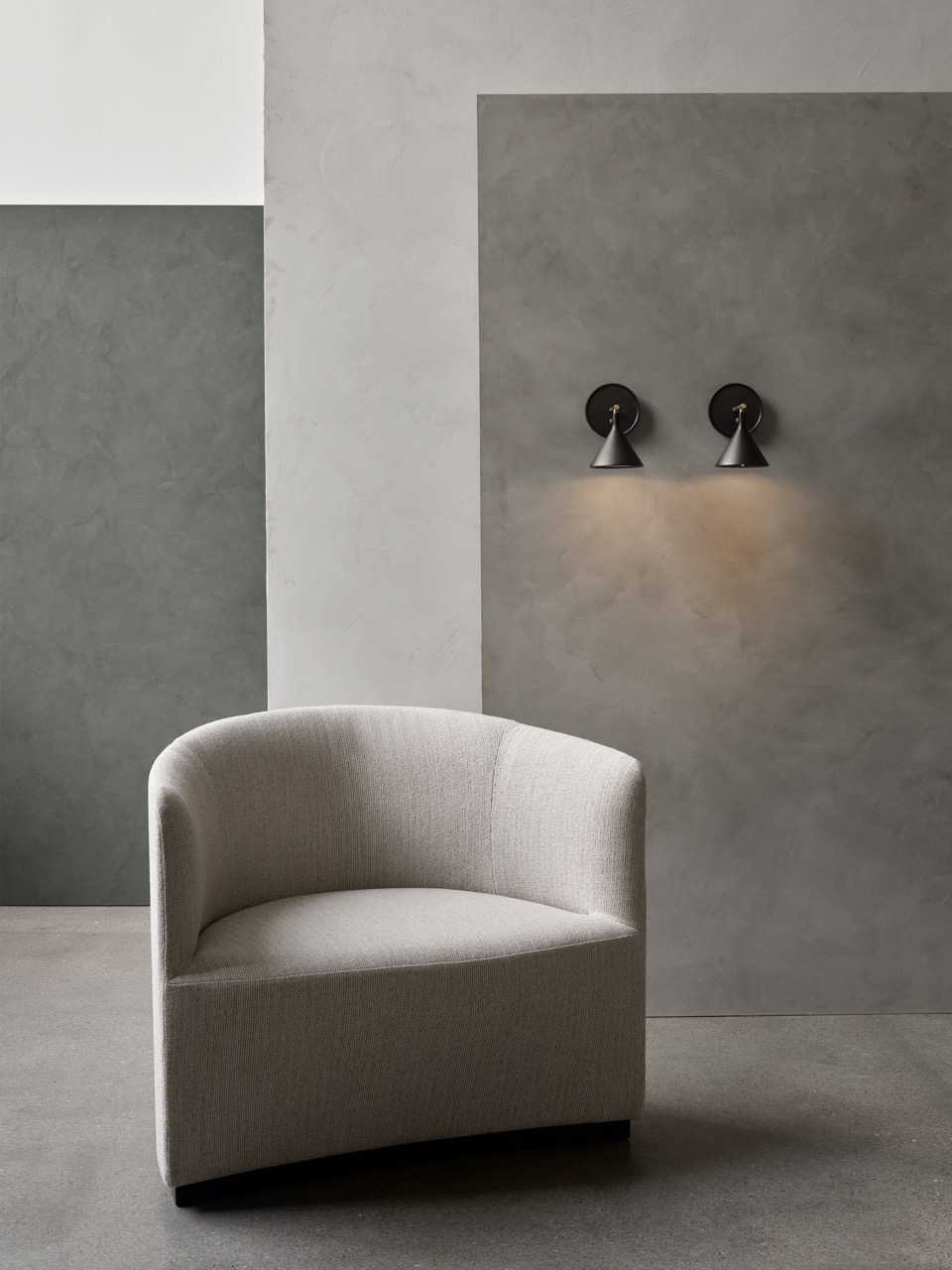 'Tearoom' armchair with the new cast sconce in the background.