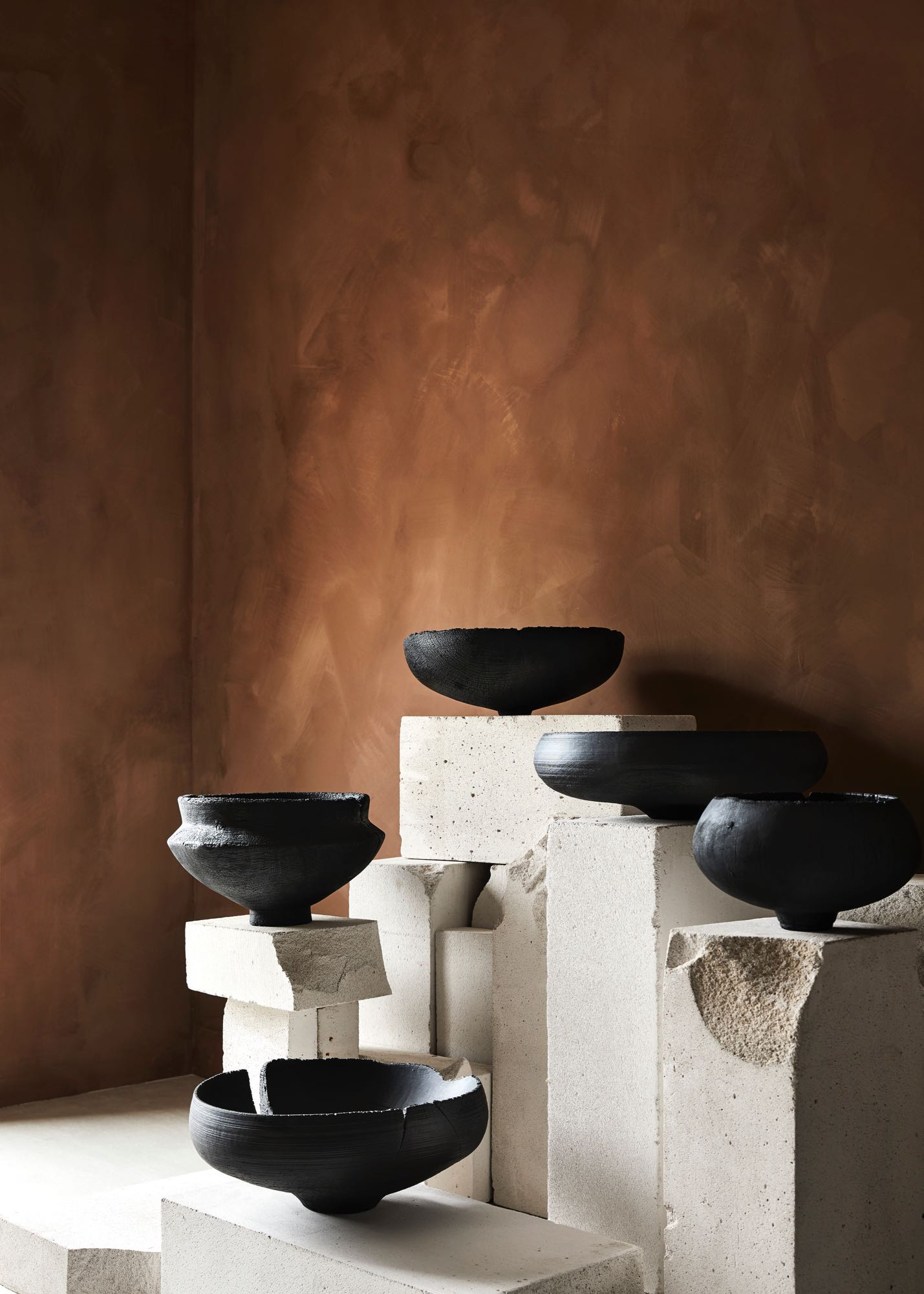 The beautiful work of Makiko Ryujin balancing on delightfully distressed plinths.