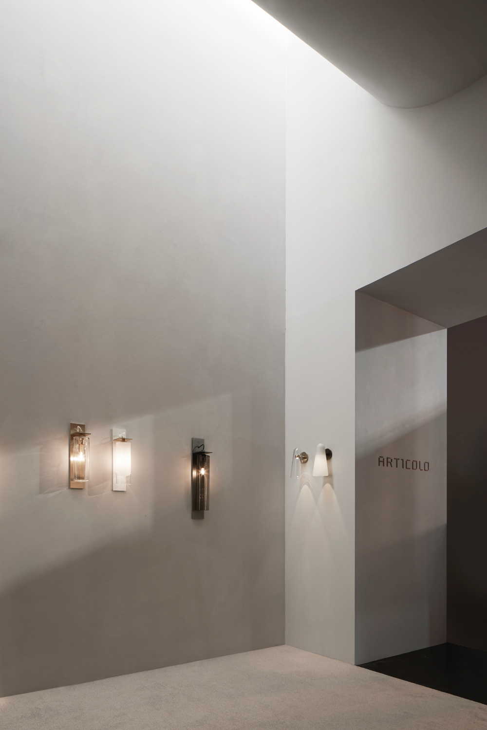 Articolo stand at Euroluce 2019 showing three variations of the Eclipse wall sconce on the left and two of the Domi wall sconce (in clear and frosted) on the right. Photograph: Willem-Dirk du Toit.