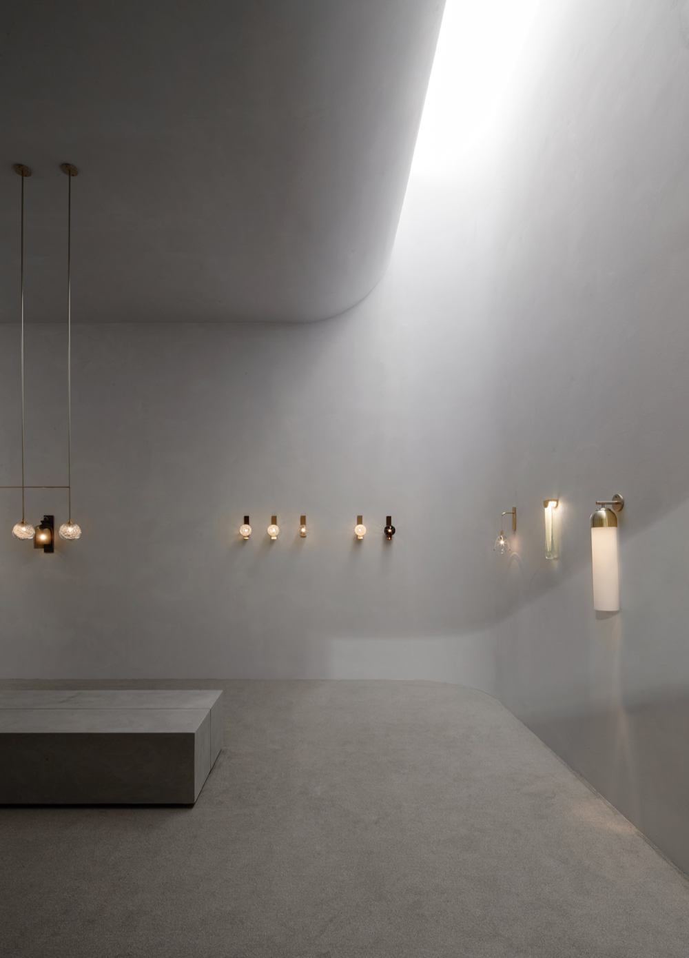 Articolo stand at Euroluce 2019 with Fizi triple ball with brass bar pendant on the left, Fizi wall sconces on the rear wall and Ici, Slab and Float on the right. Photograph: Willem-Dirk du Toit.