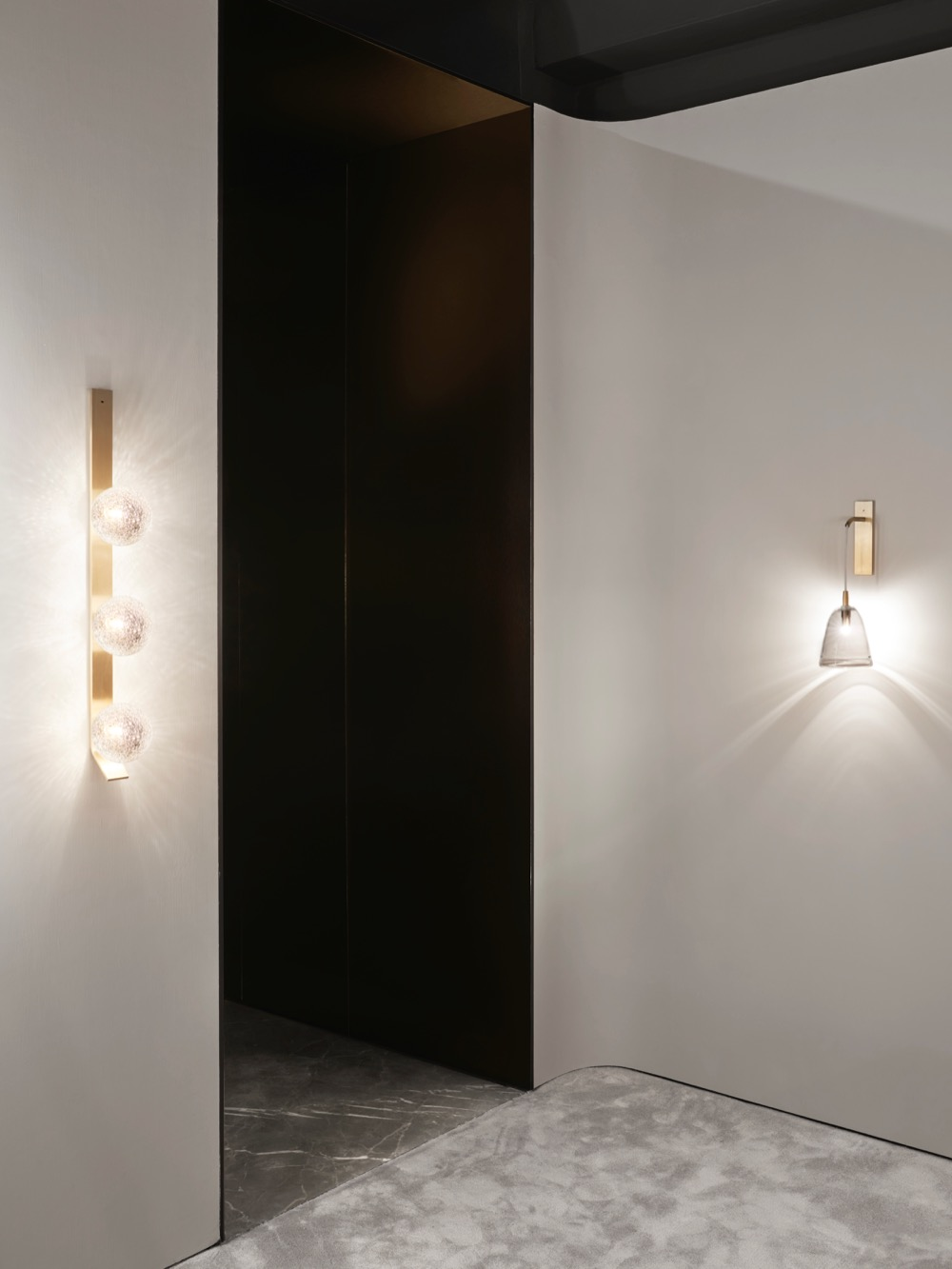 The Articolo New York showroom showing the Fizi Triple ball wall sconce and Ici wall sconce in glass (also available in porcelain). Photograph: Brooke Holm.