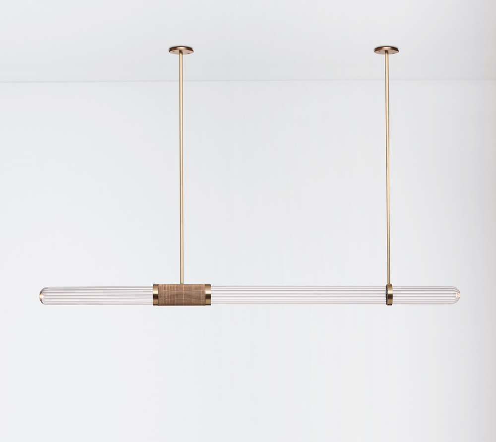 The new Articolo Scandal pendant light in blown glass and brass with antique brassmesh binding.