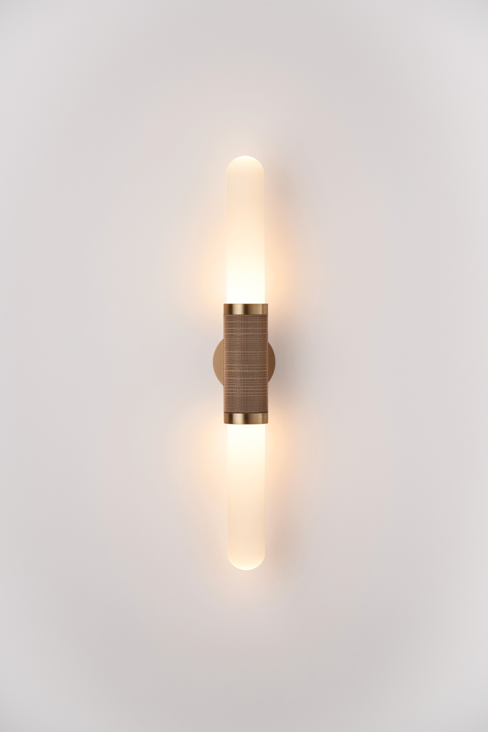 Scandal wall sconce in etched glass with antique brass strapping.