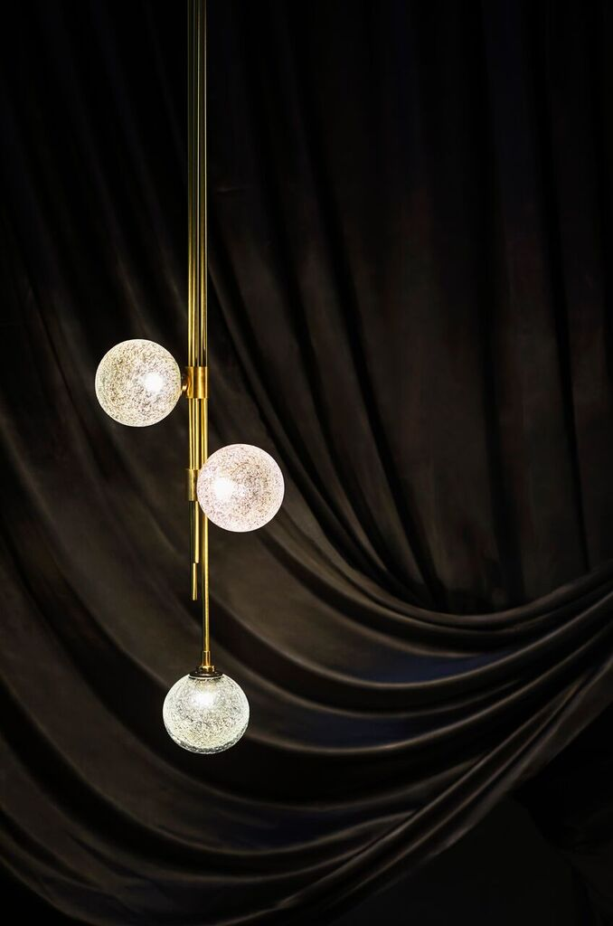 Trilogy three ball pendant in the Melbourne showroom. Photography Sharyn Cairns.