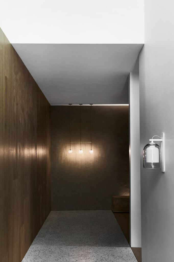Articolo's flagship  showroom in Melbourne with a Lumi wall sconce in the foreground. Photograph by Sharyn Cairns.