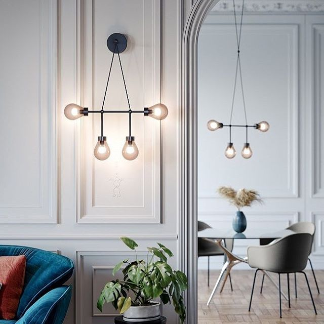 The new Zoe wall sconce by Chiara Andreatti and Studio Salaris for Italian lighting brand MM Lampadari. The collection includes the wall sconce as shown in the foreground plus two suspension lights - one of which is shown in the background in this image. The lights have a carbon black metal structure with pale pink or Smokey grey hand blown glass shades. @mmlampadari #italianlighting #mmlampadari #chiaraandreattidesigns