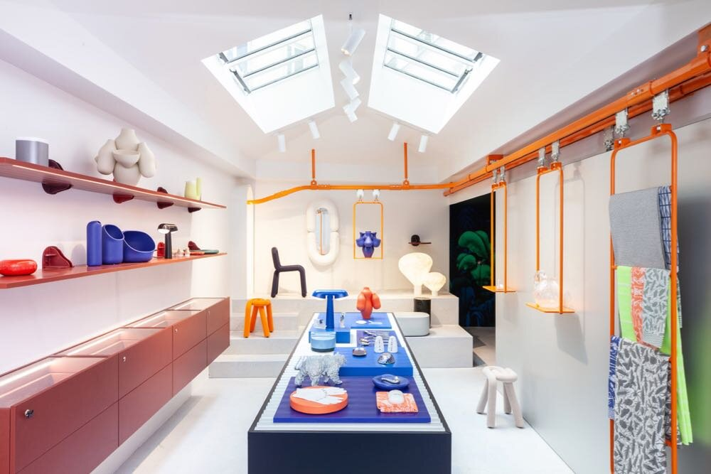 The new Moustache store in Paris designed by xx with its bright orange moving track display system.