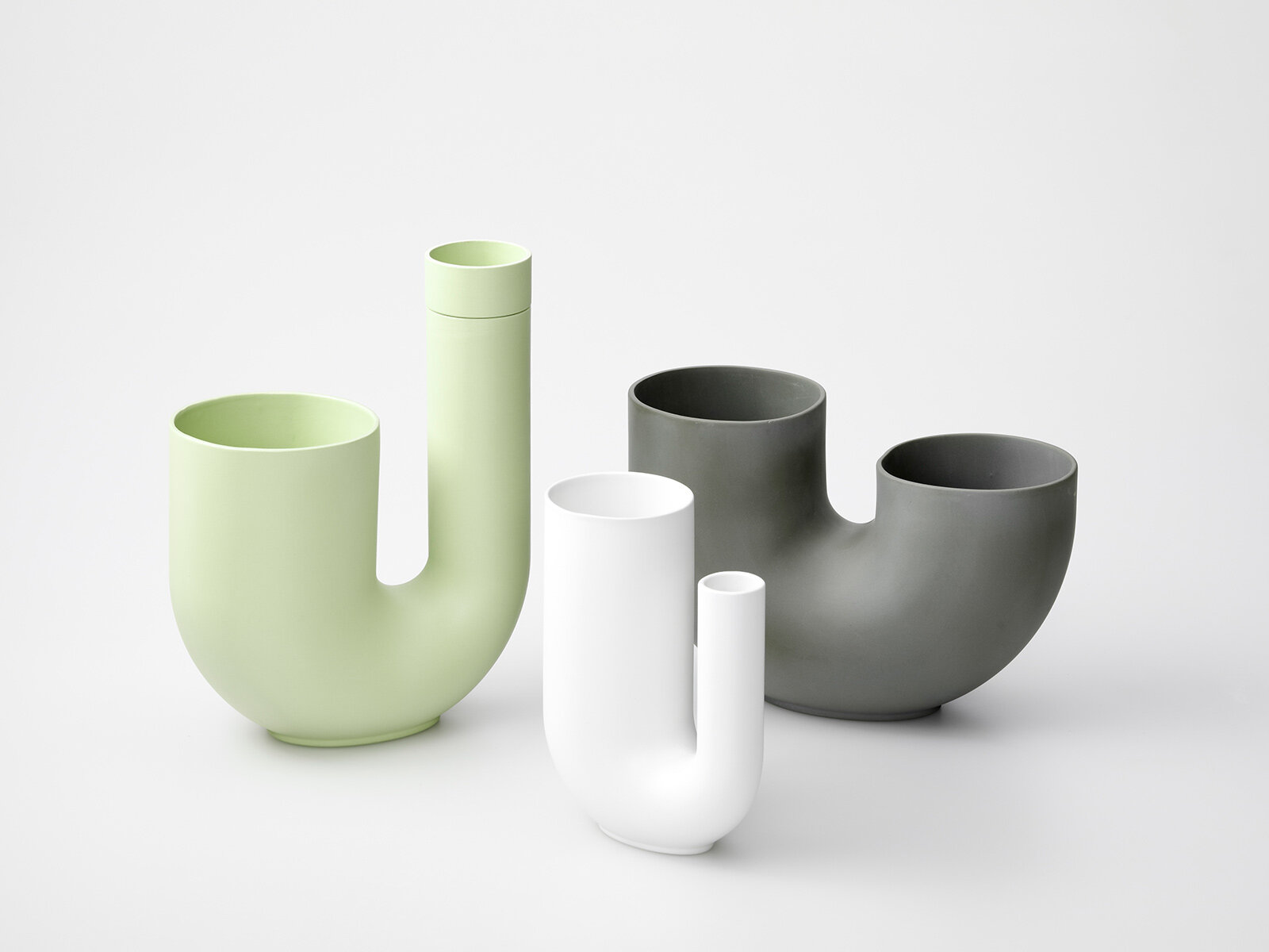 Sebastian Bergne's  Ha' Porcelain vases 'Tuba' and 'Fruit'.  Ha' Porcelain  is a new company that brings contemporary design together with traditional porcelain workshops in Japan. Photograph by Ruth Ward.