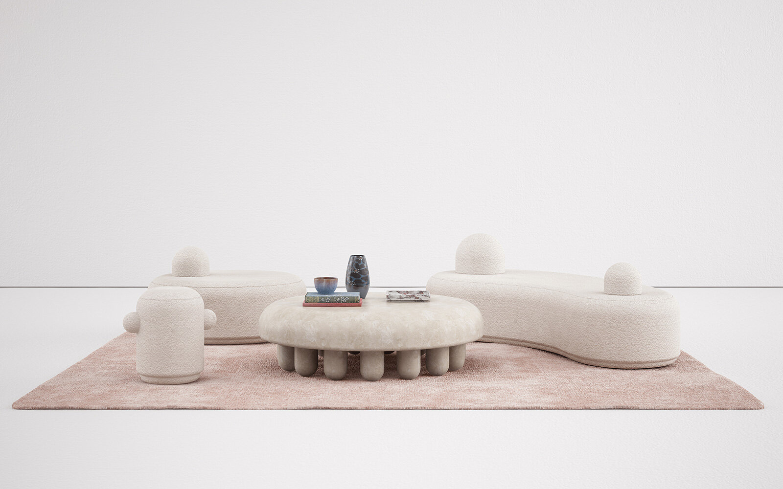 The  Orsetto  collection by Martin Massé for Kolkhoze. The coffee table is travertine, the upholstery is in Dedar wool boucle.