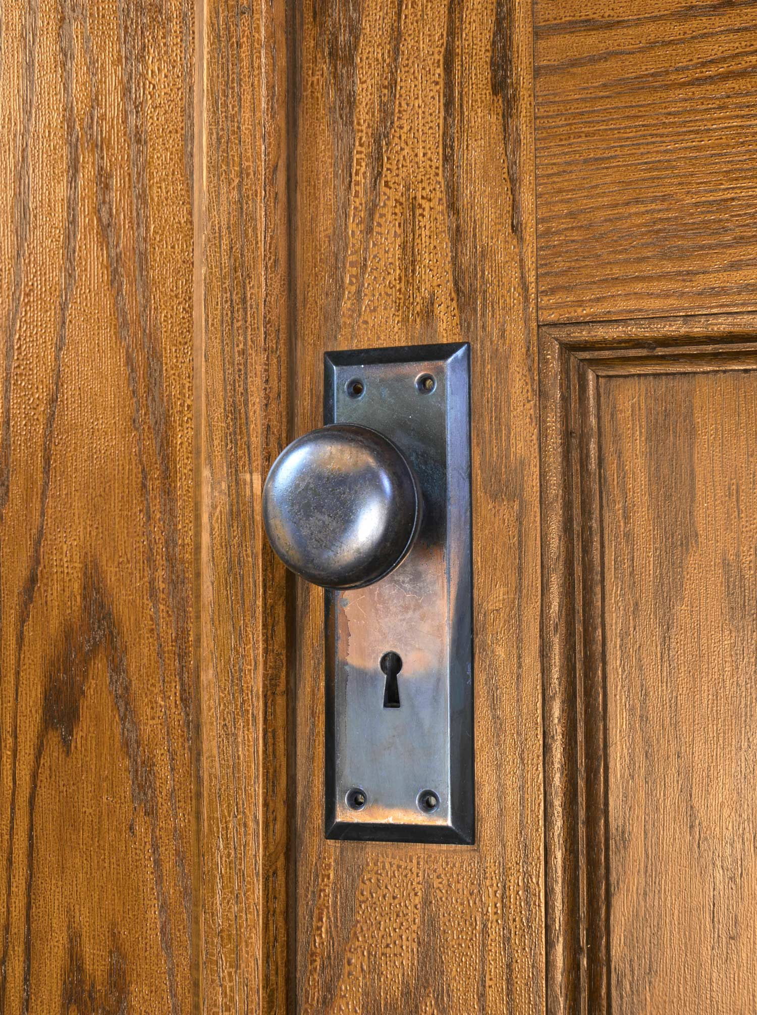 46116-tall-oak-double-doors-with-beveled-glass-knob-detail.jpg