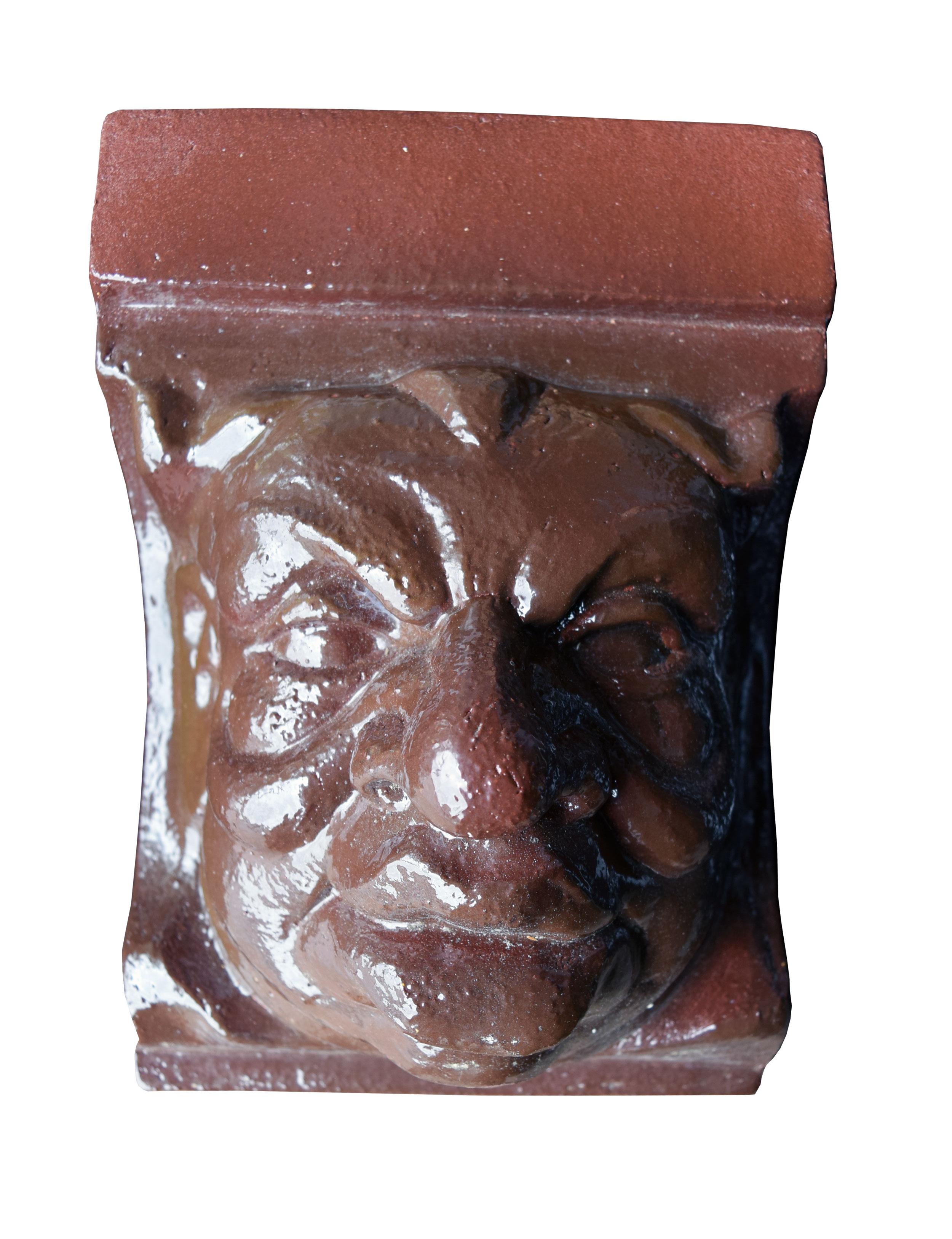 47239-glazed-terra-cotta-faces-mad.jpg