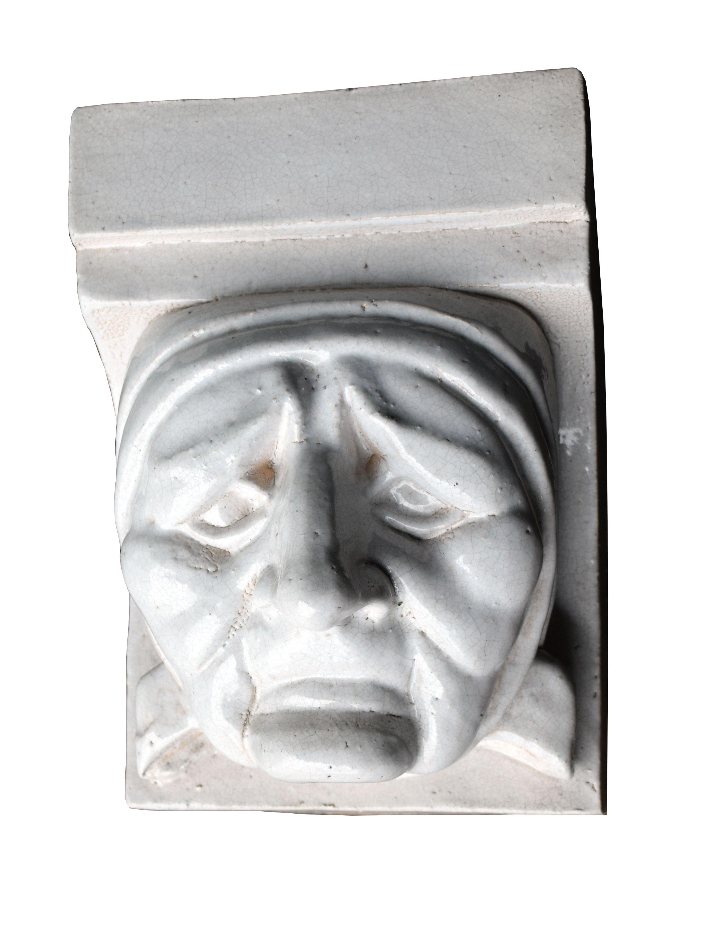 47239-glazed-terra-cotta-faces-sad.jpg