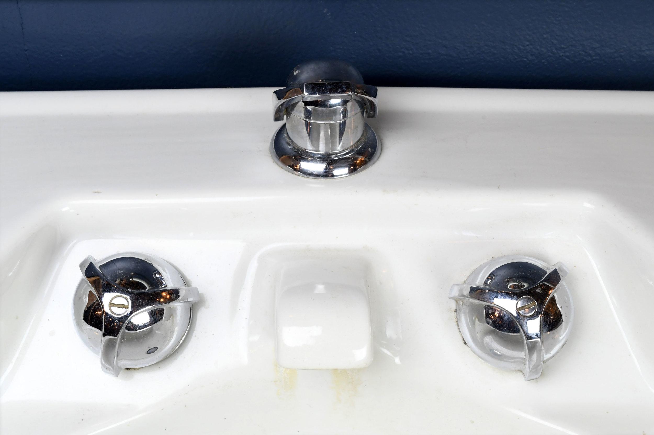 47249-1950s-wall-mount-sink-faucet-detail.jpg