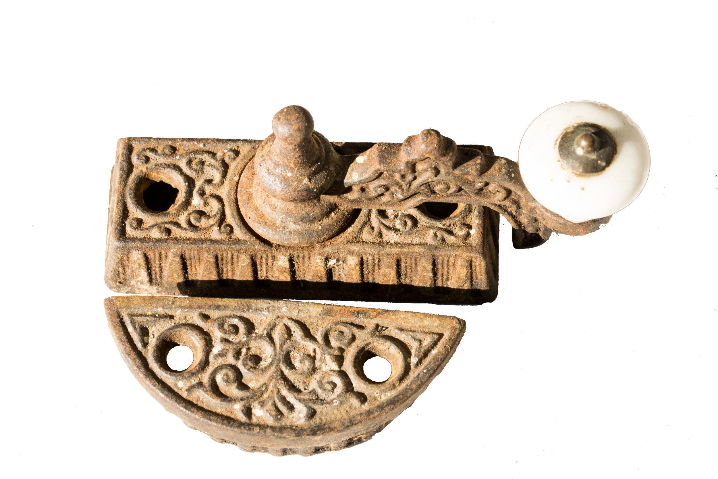 porcelain and iron window sash lock