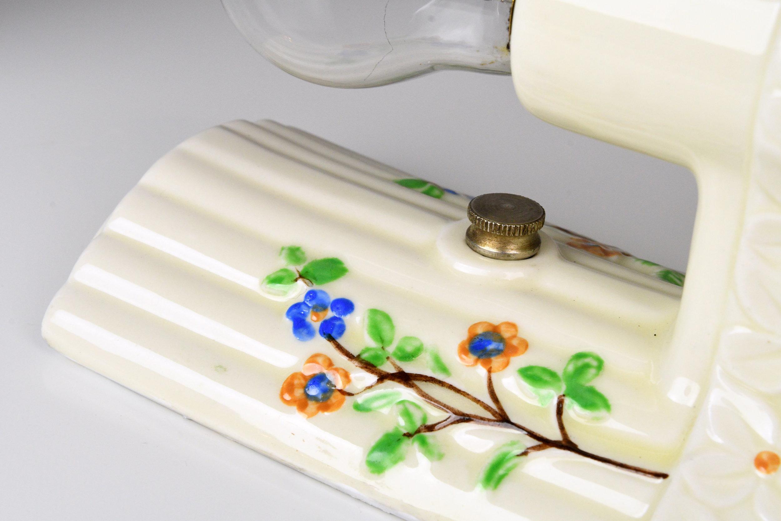 47767-porcelain-floral-bathroom-sconce-detail.jpg