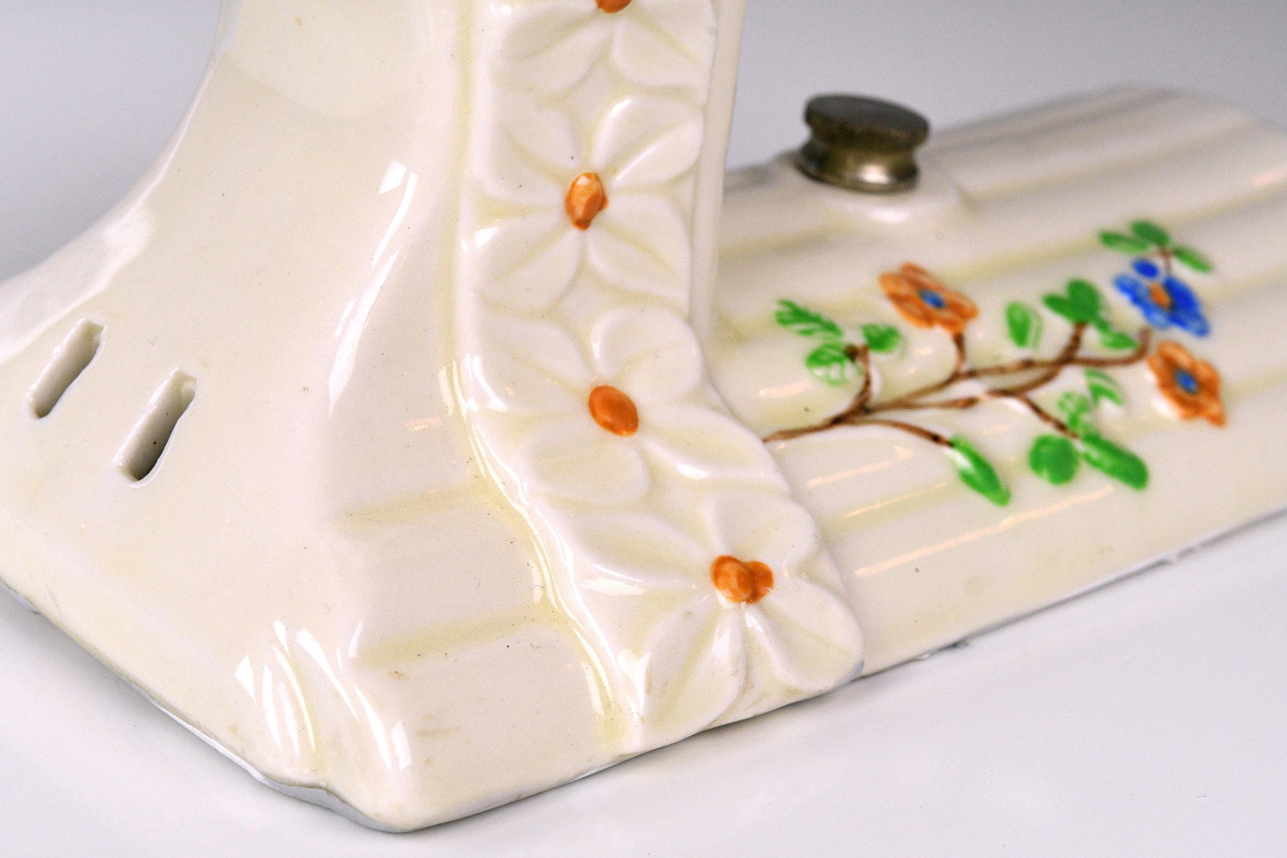 47767-porcelain-floral-bathroom-sconce-floral-detail.jpg