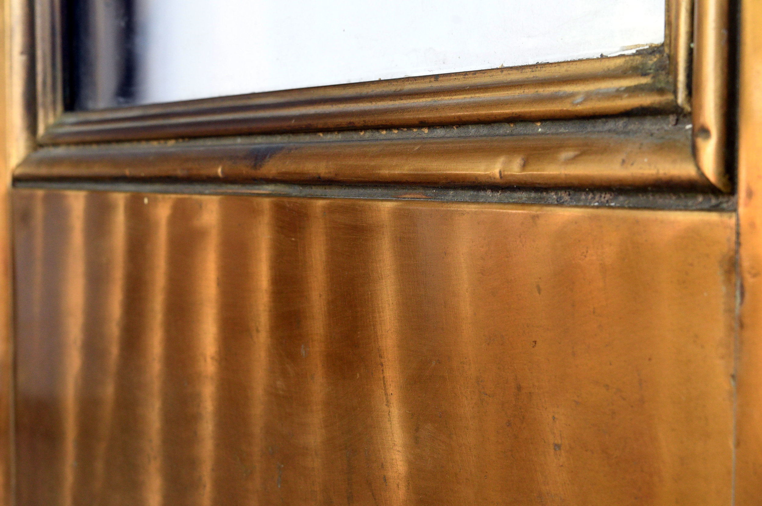 47865-brass-clad-doors-rippling-metal.jpg