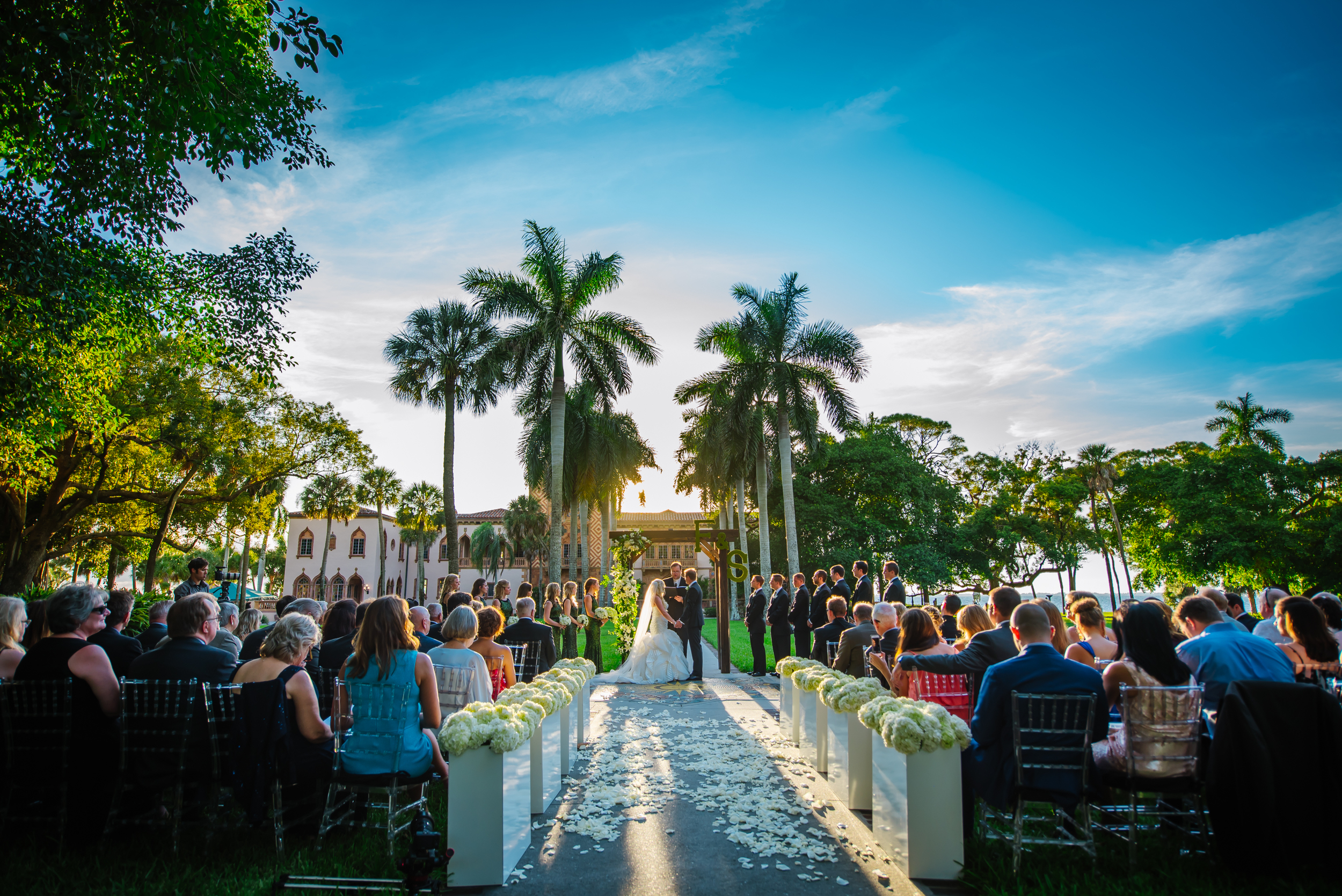 tampa-wedding-photographer-ca-dzan-luxury-ceremony-vibrant-blue-sky