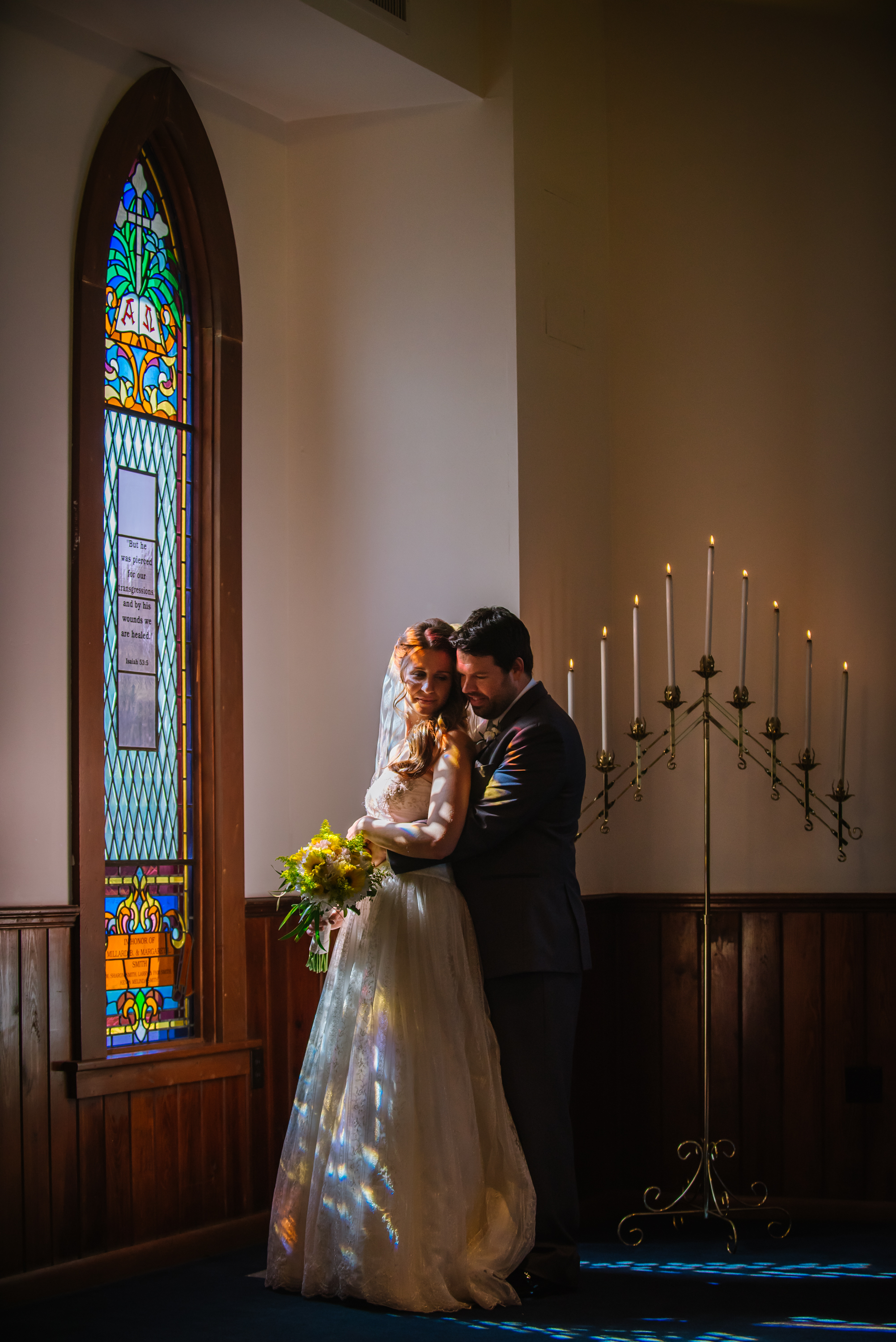 Awww Lindsey & Brad are traditional and deep. I couldn't resist the light coming through the stained glass at their chapel and their classic embrace fit just right.