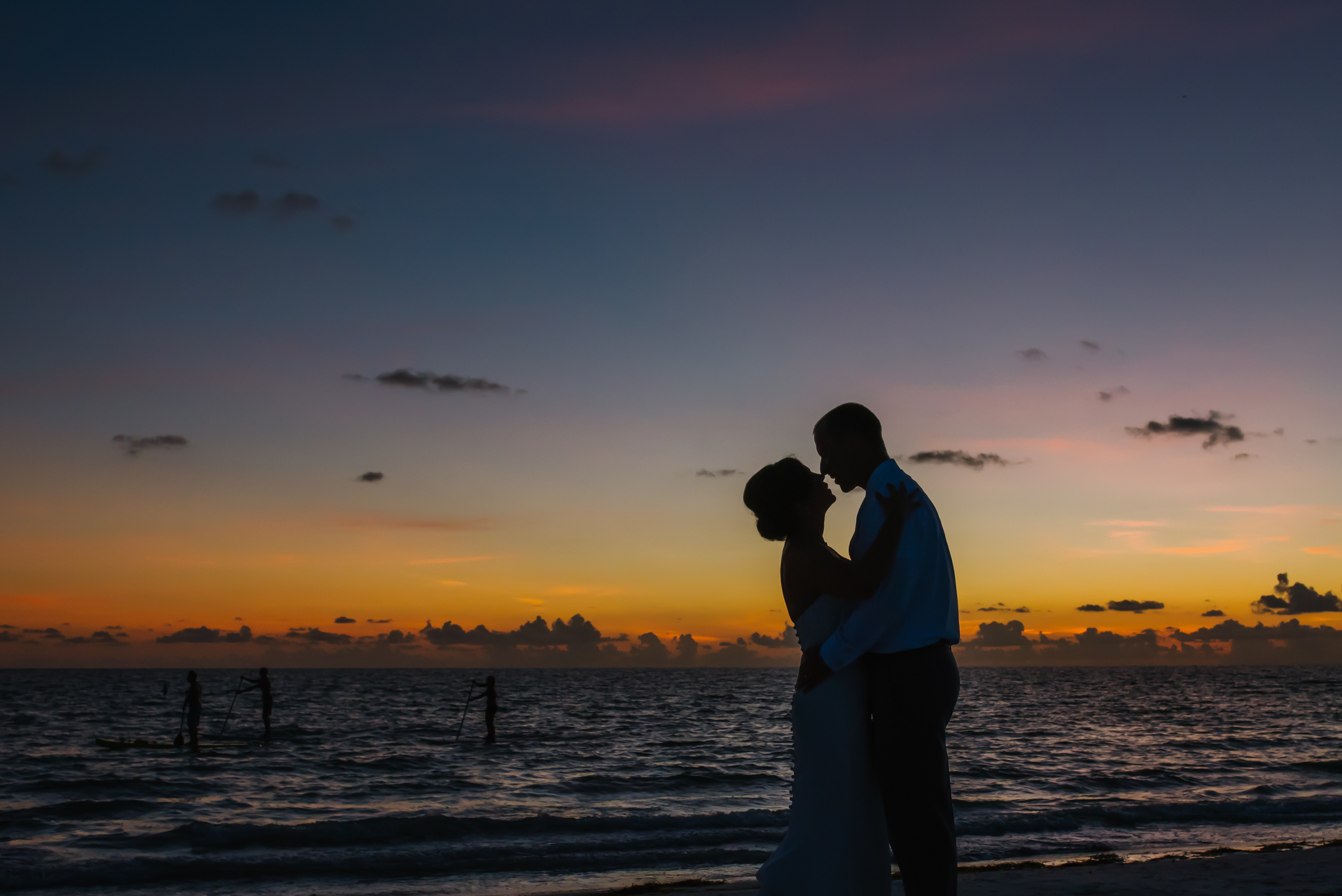 Melissa and Micheal were such a blast! They were so hilarious and irreverent! But when it came time for a few moments alone for the sunset they were so romantic and lovely. I love this frame of them holding each other close as the paddle boarders sneak by in the distant surf.