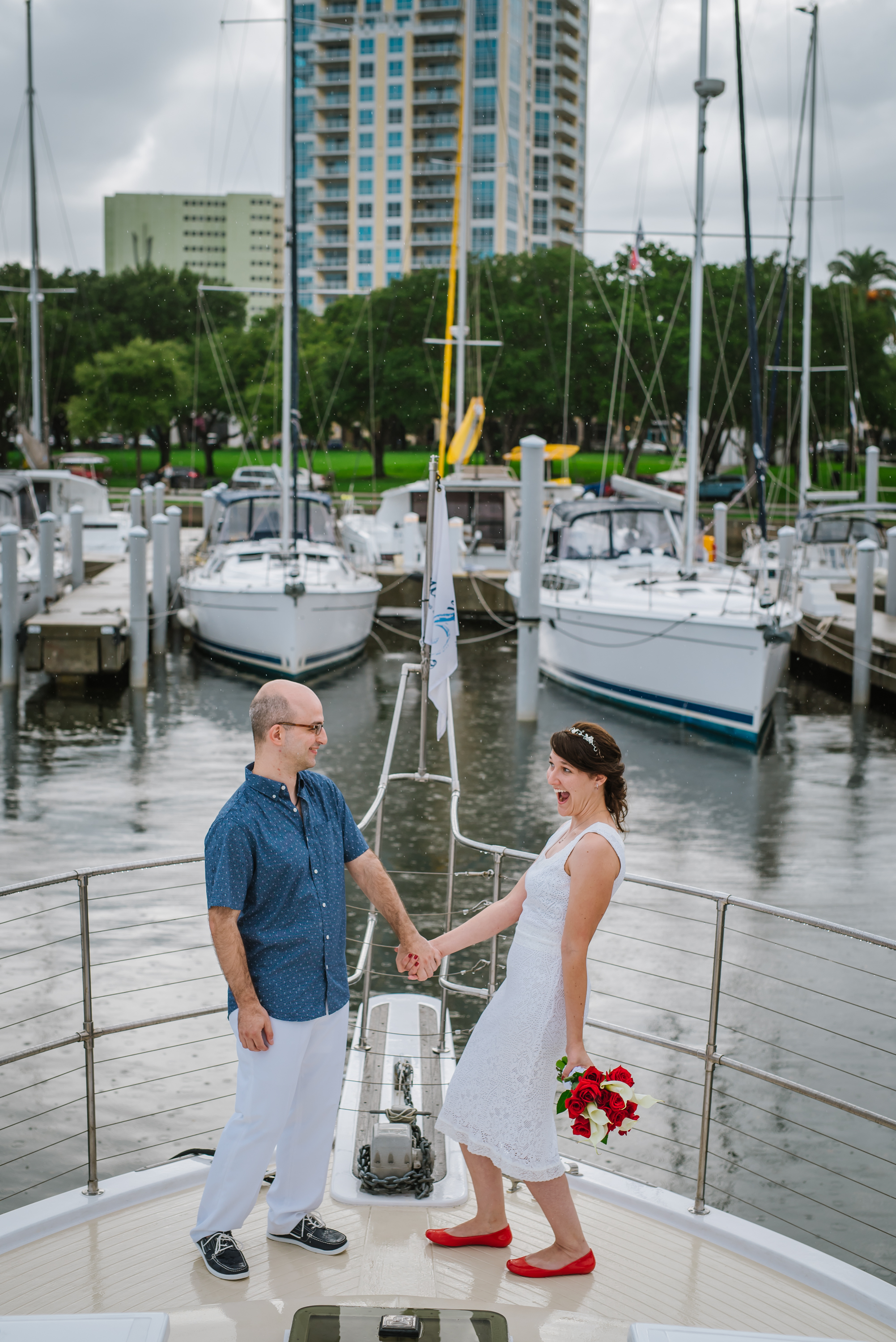 Lisa and Ted are such goofballs! I love how they didn't let a little rain dampen their awesome yacht elopement!