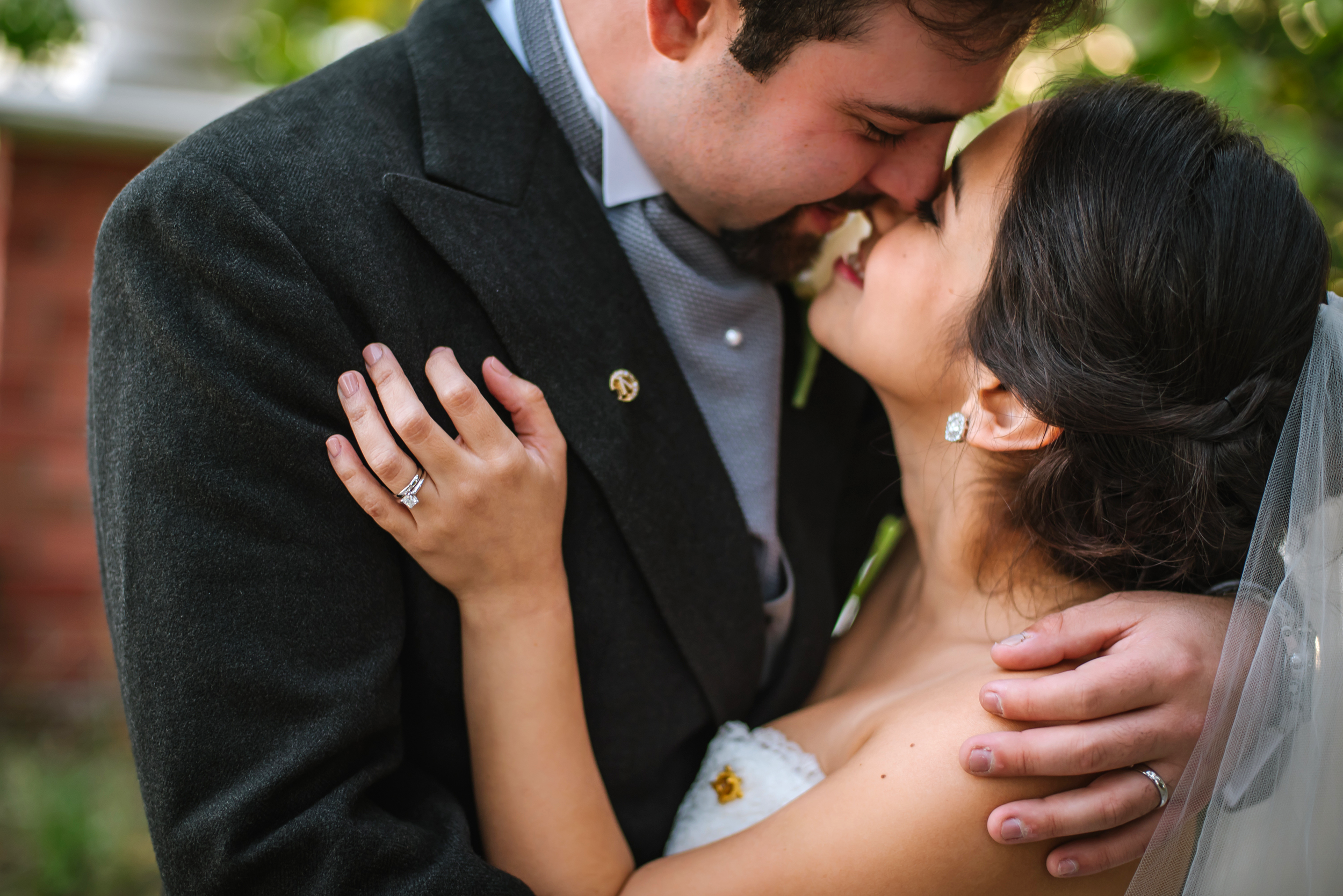 My first weeding of the year was with Brigitte & Roberto. They are the most tender and sweet couple you'll meet. I chose this photo because of their adorable embrace and how it shows off their wedding bands and their treasured family pins.