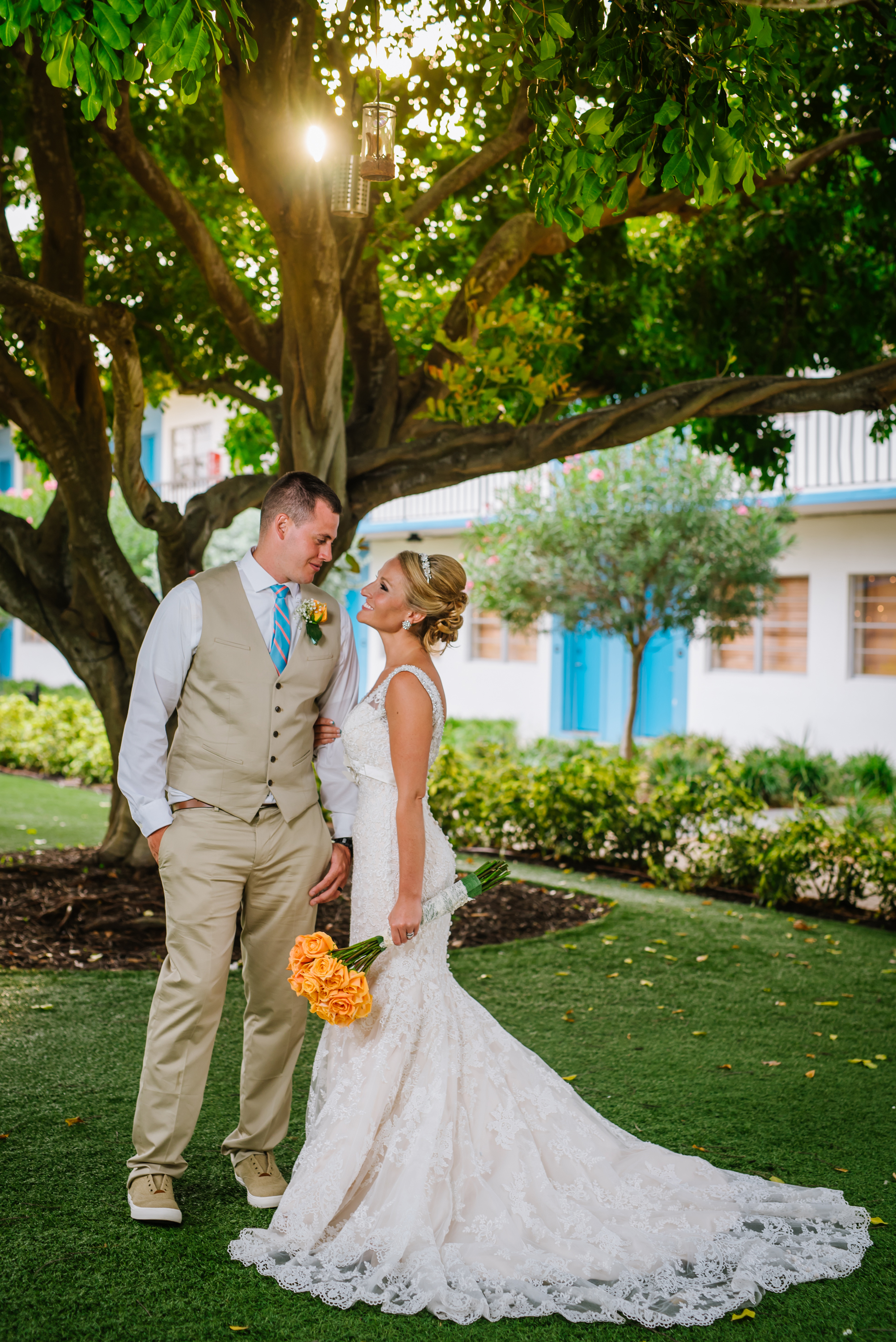 Josie and Joey had a vibrant and tropical wedding day at the Post Card Inn and I just love how the sun is coming through on their portrait...and that dress!! WOW!