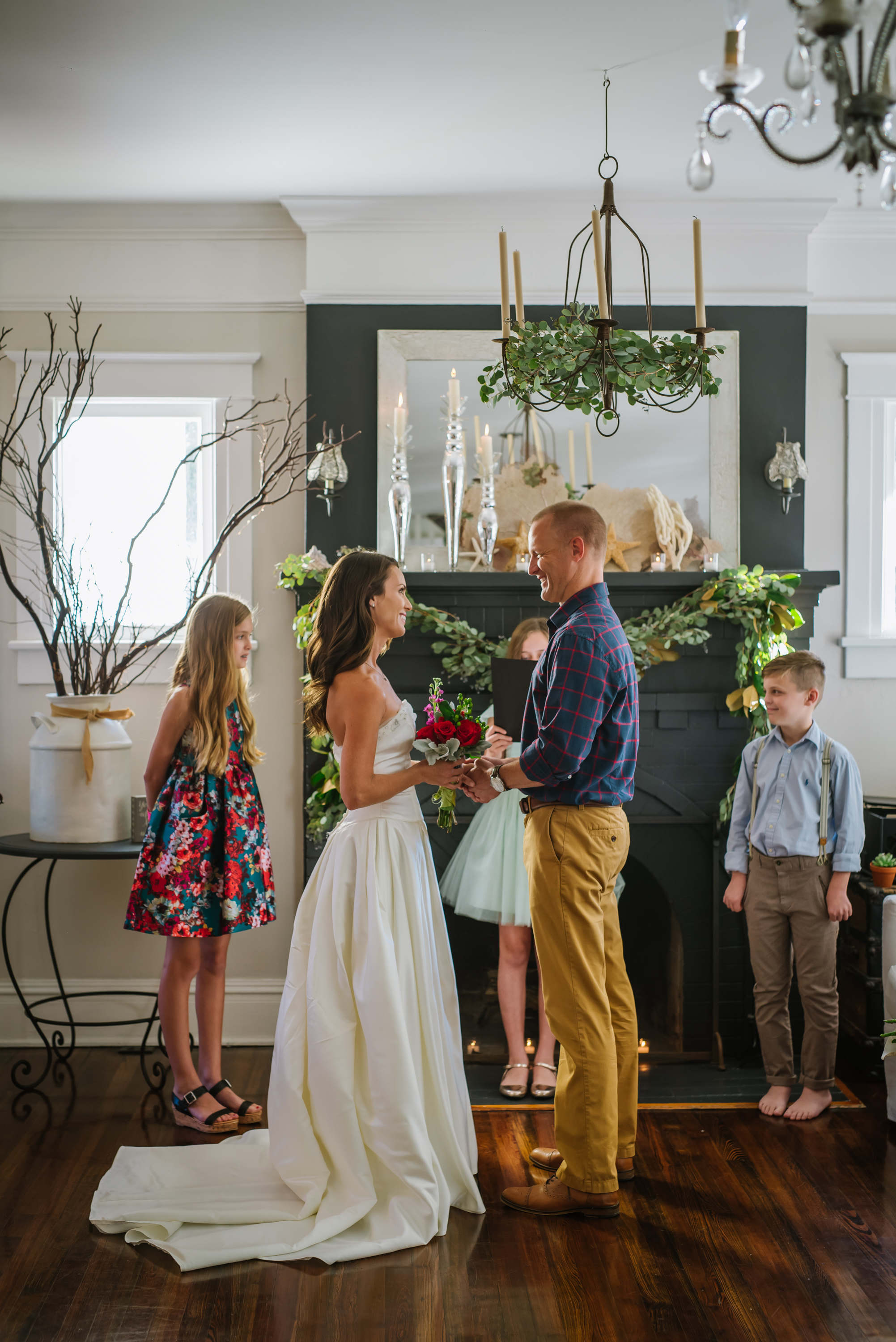Valynnda and Steven celebrated their 15 year wedding anniversary with a SURPRISE vow renewal in their home! She is in her original wedding dress people! And their THREE children were amazing. It was the most intimate and inspiring ceremony yet.