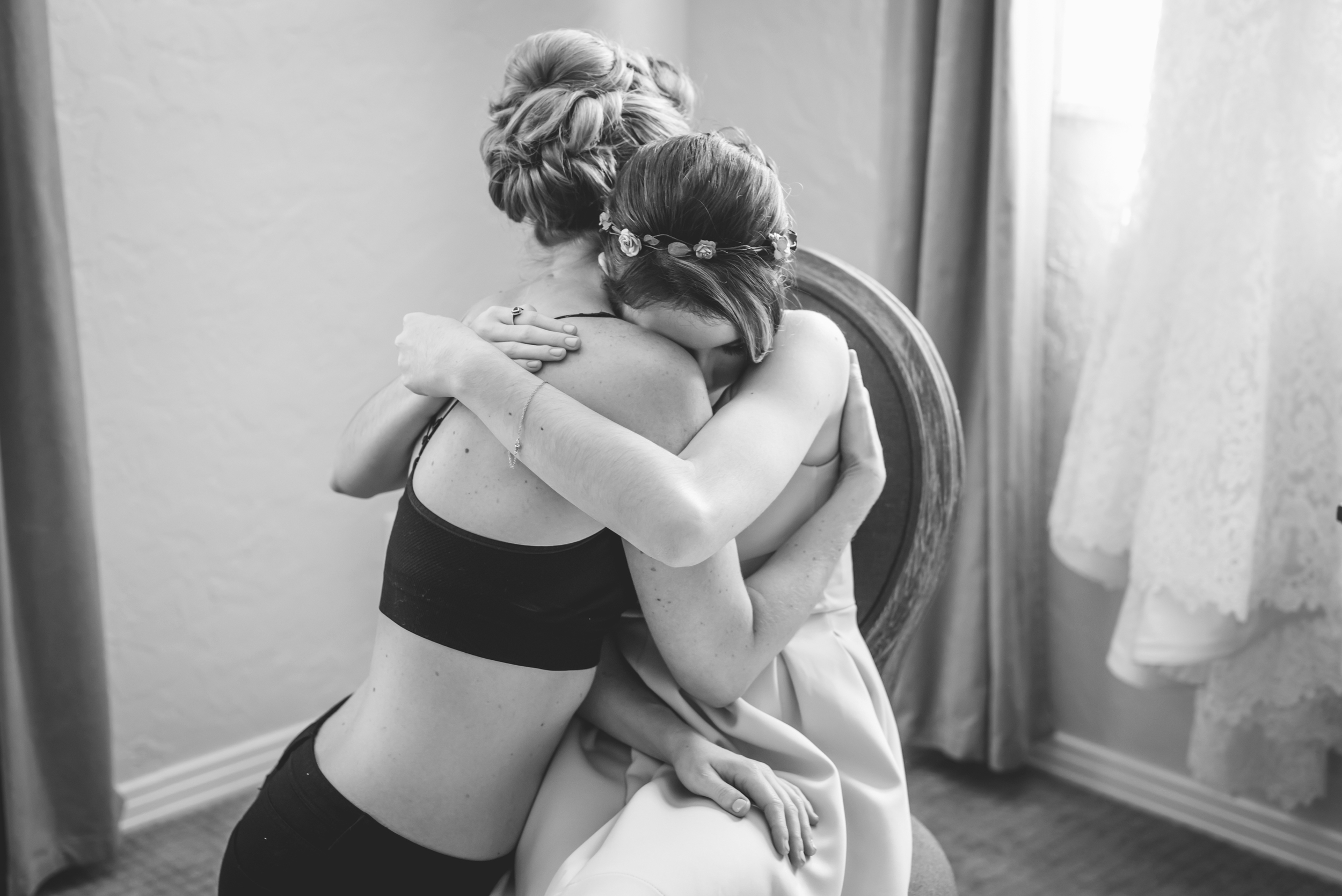 tampa-wedding-photographer-black-white-bw-candid-intimate-hug-getting-ready