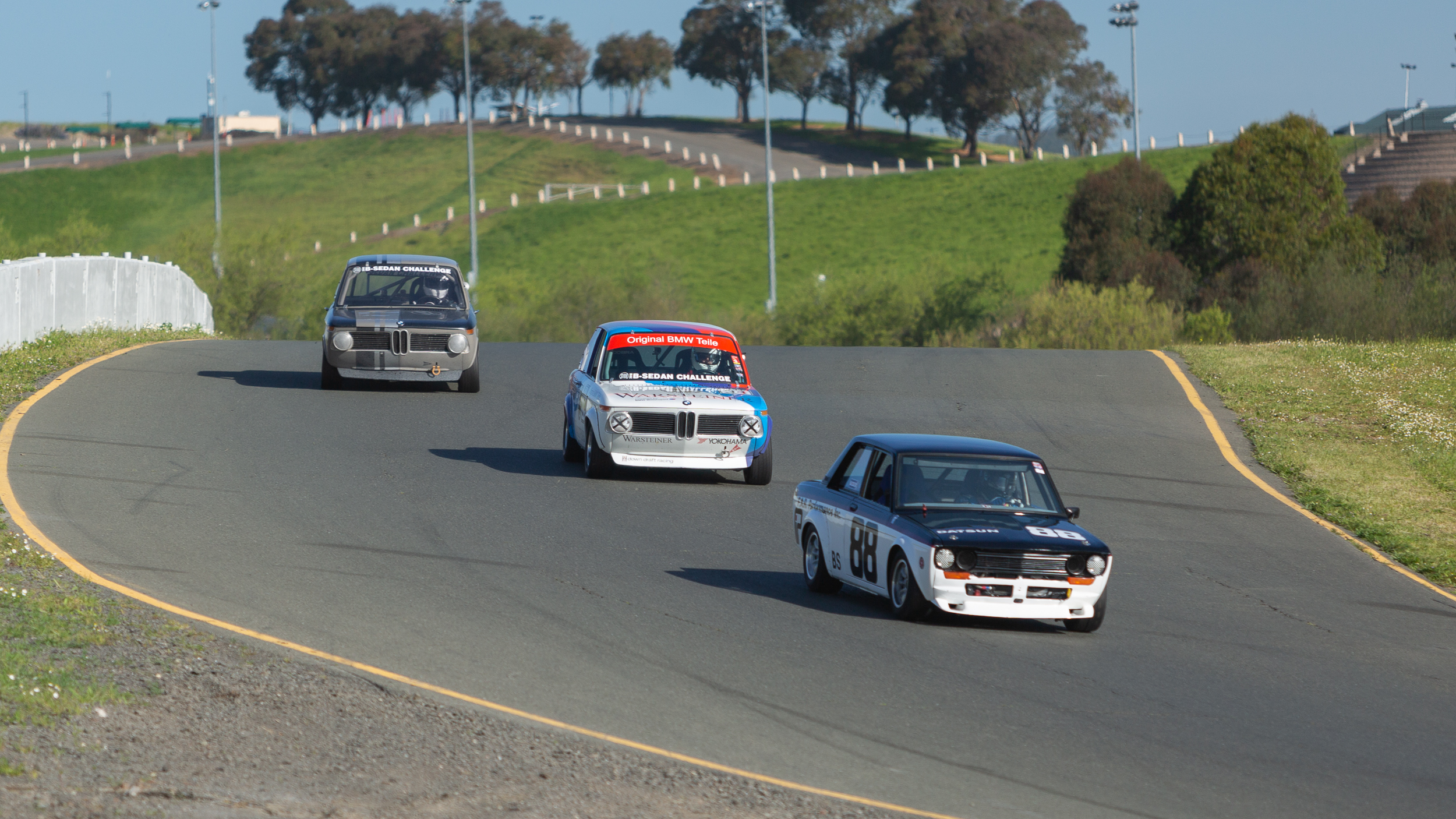 Battle of the B Sedans during the John Morton Cup race