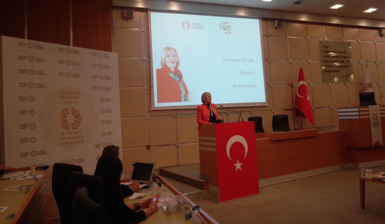Margaret Hirsch  at the speaker podium giving her talk in Turkey