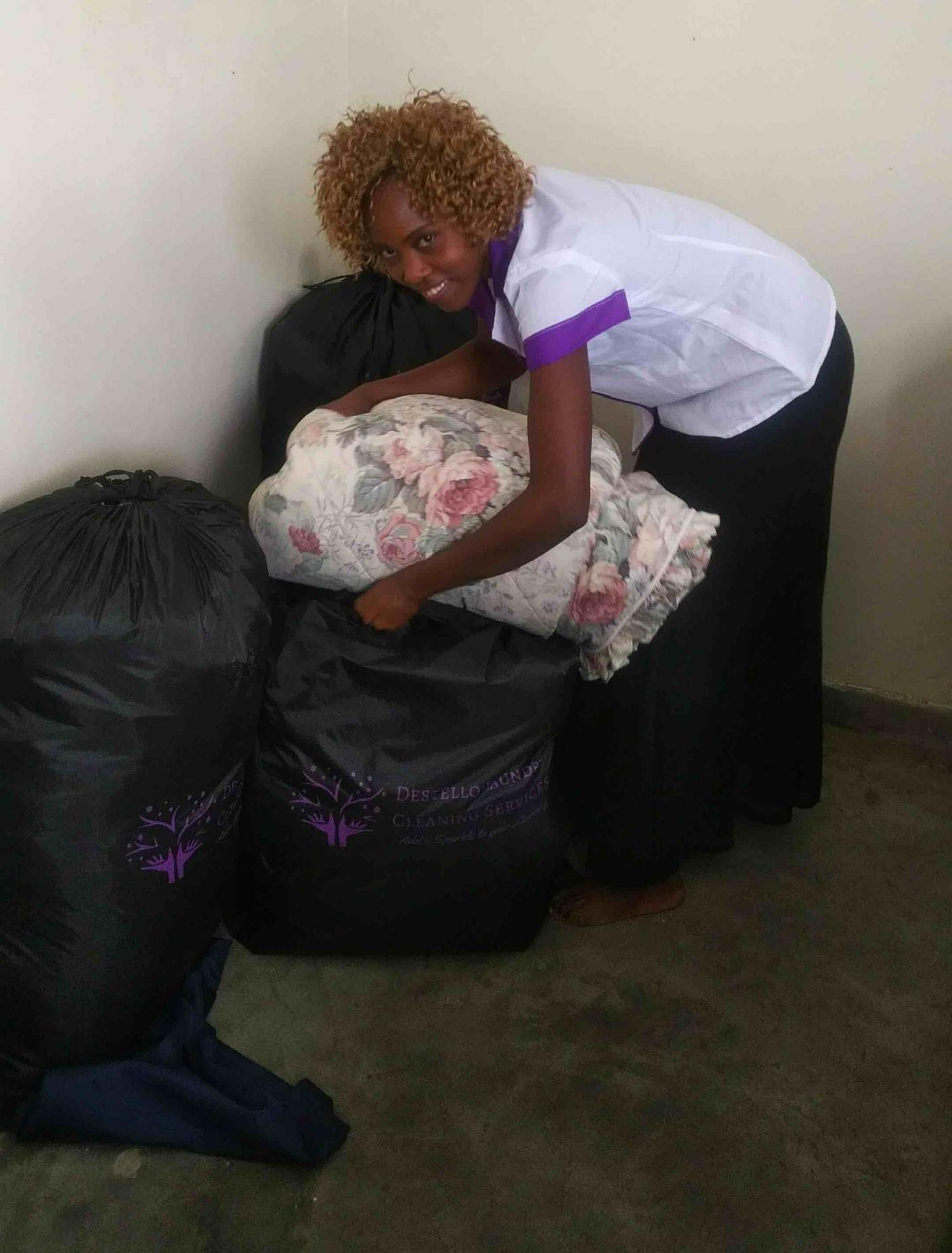 Sarah-Destello Laundry packing a clean duvet.jpg
