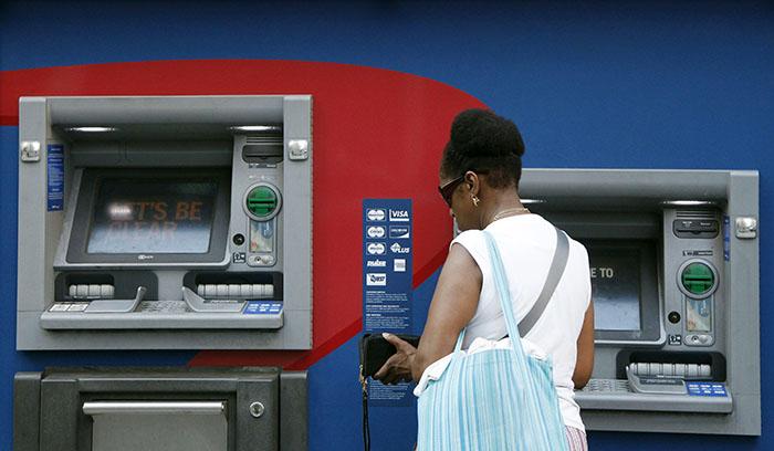 atm-cash-machine-woman.jpg
