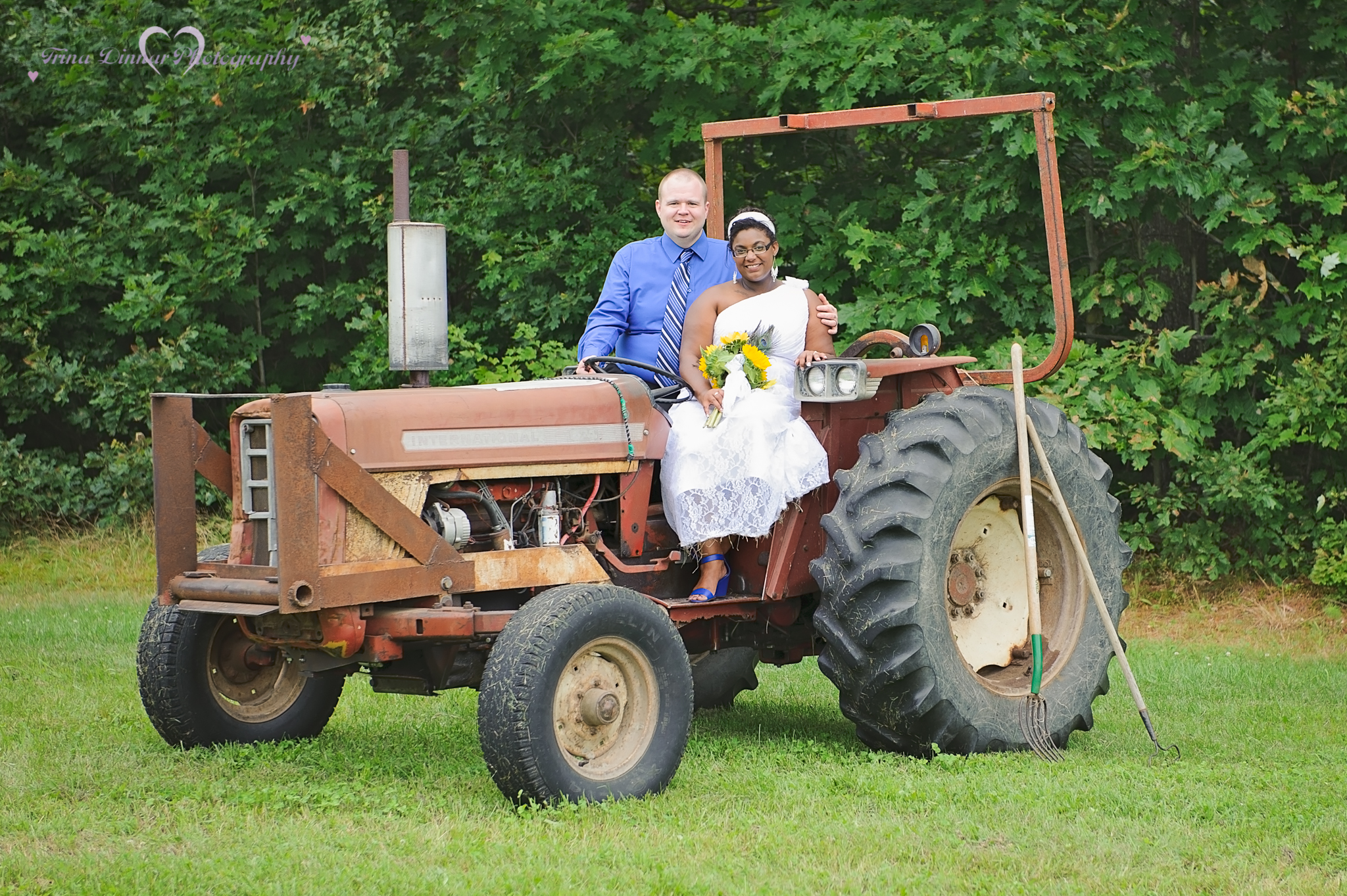 bride and groom on a tractor on their wedding day