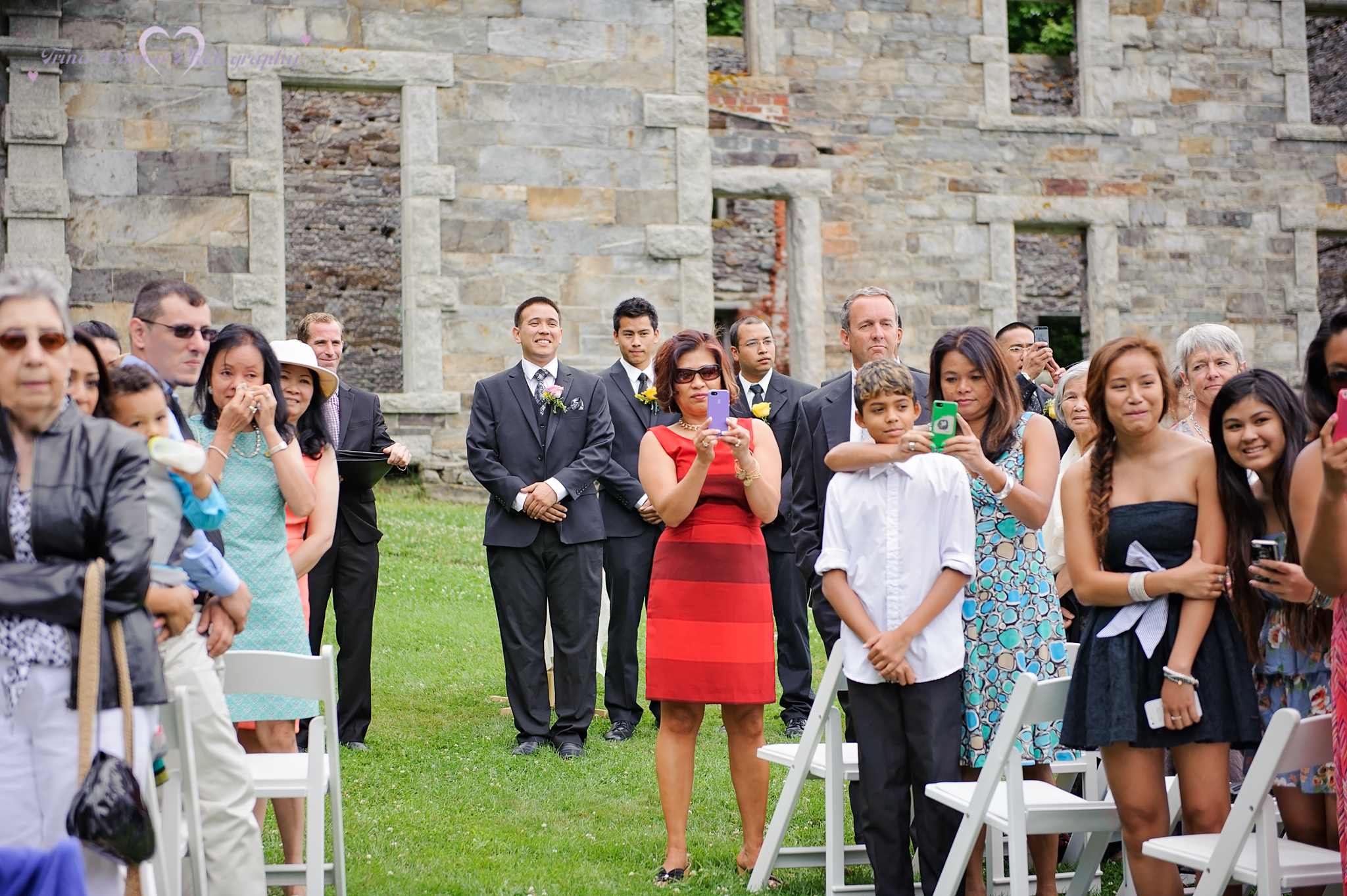 Groom's reaction seeing bride for the first time at their wedding ceremony at the Goddard Mansion in Fort Williams Park, Maine.