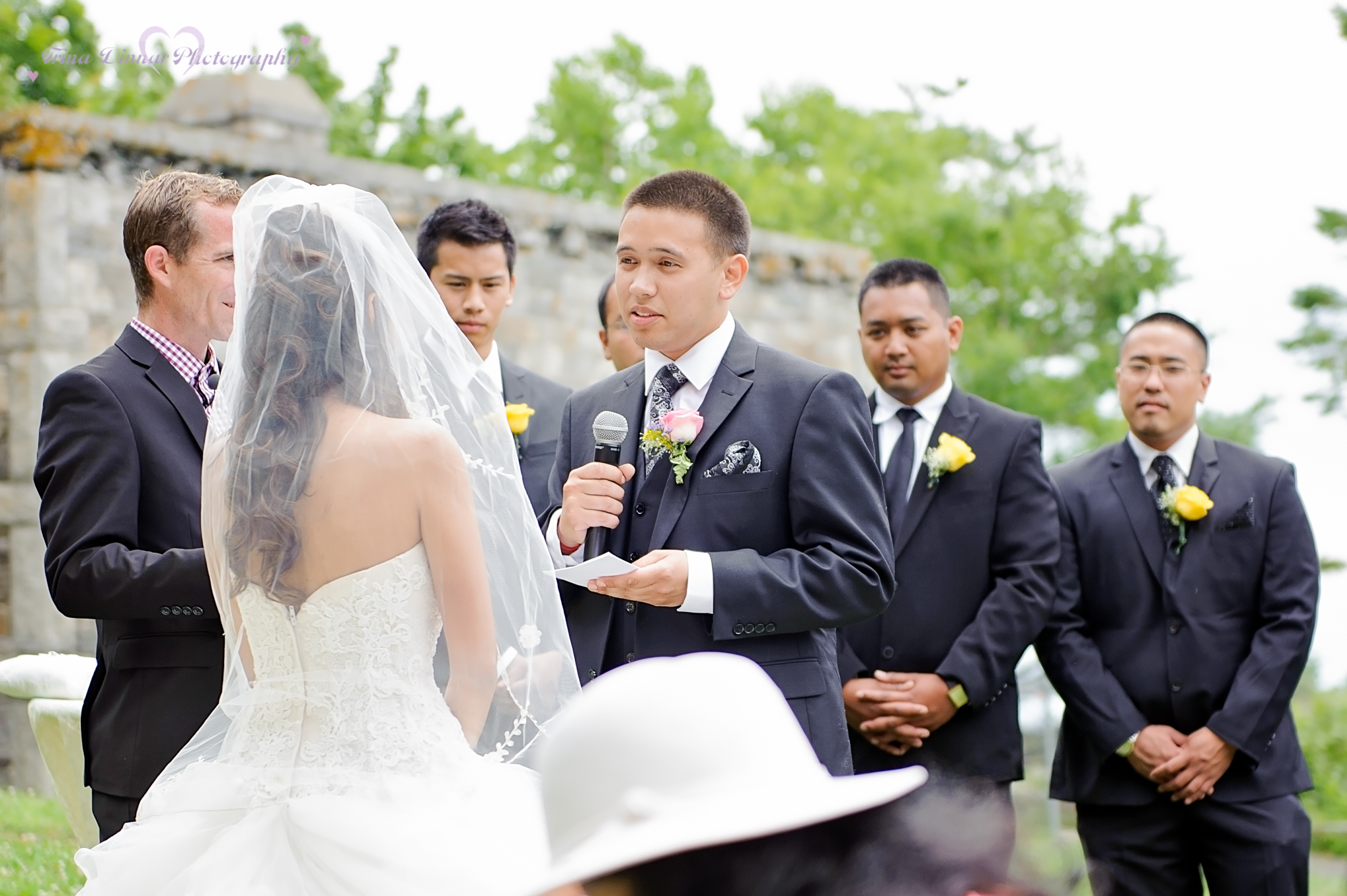 The groom saying his vows as the groomsmen look on at their Cape Elizabeth wedding in Maine
