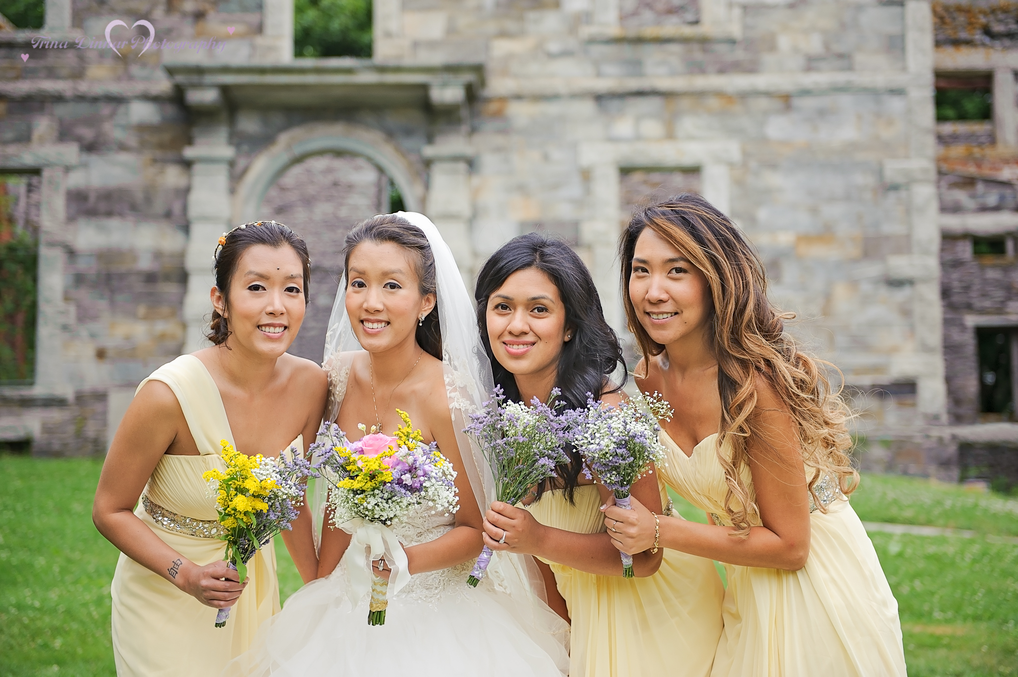 Bride and her bridesmaids at Fort Williams Park following a wedding ceremony in Coastal Maine