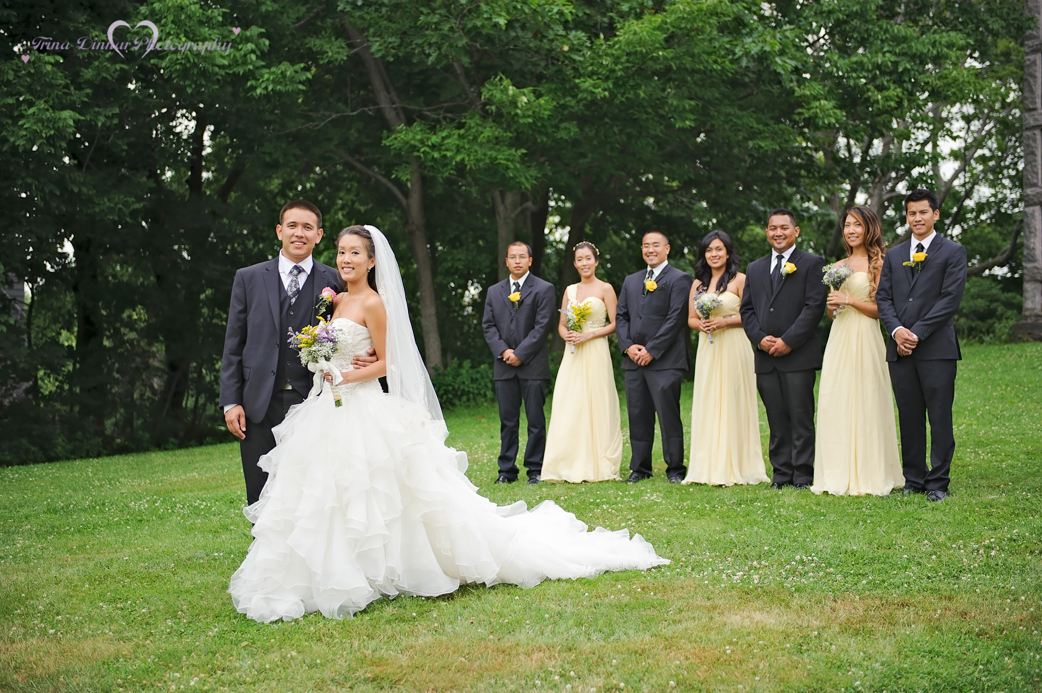 The bride and groom with their wedding party just after their ceremony near Portland, Maine