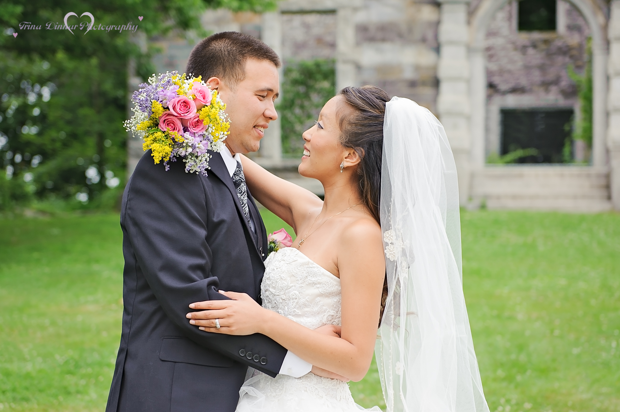 The bride and groom embrace during their Maine wedding. The photographer loved capturing their special day.