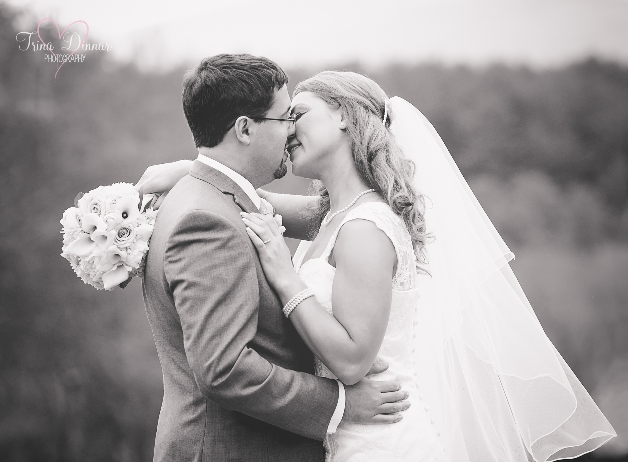 Maine wedding photographer, Trina Dinnar Photography captures kiss from bride and groom.