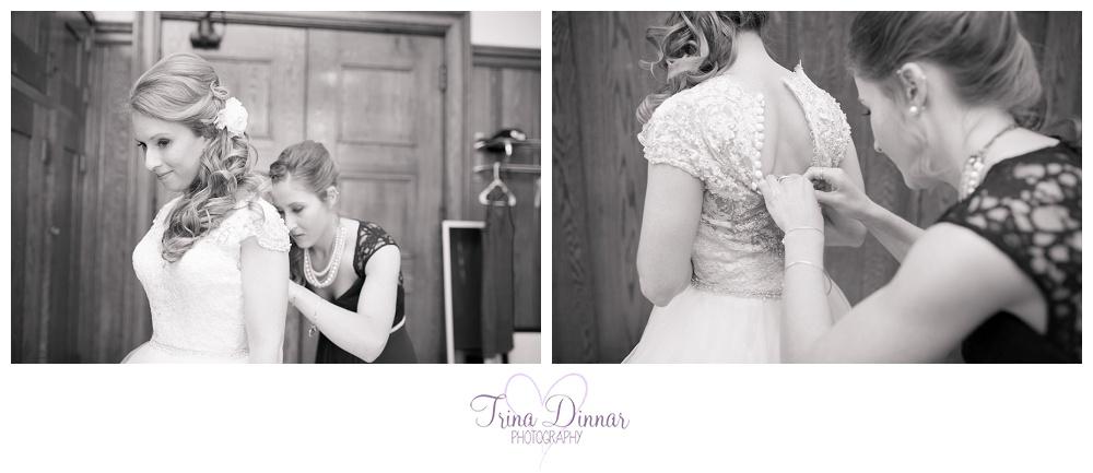 Maine bride gets into her wedding dress.