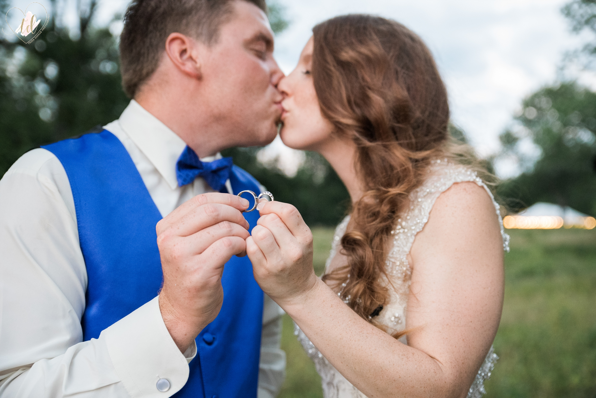Bride Groom Kiss Holding Wedding Rings