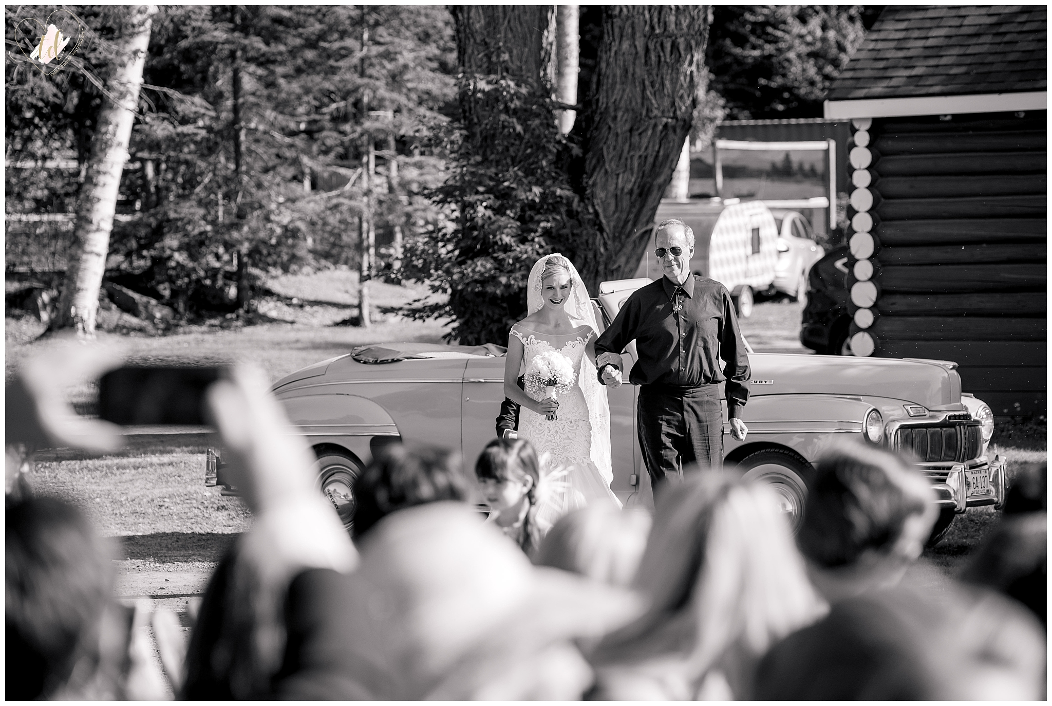 Bride walking down the aisle with her father during Maine wedding ceremony.
