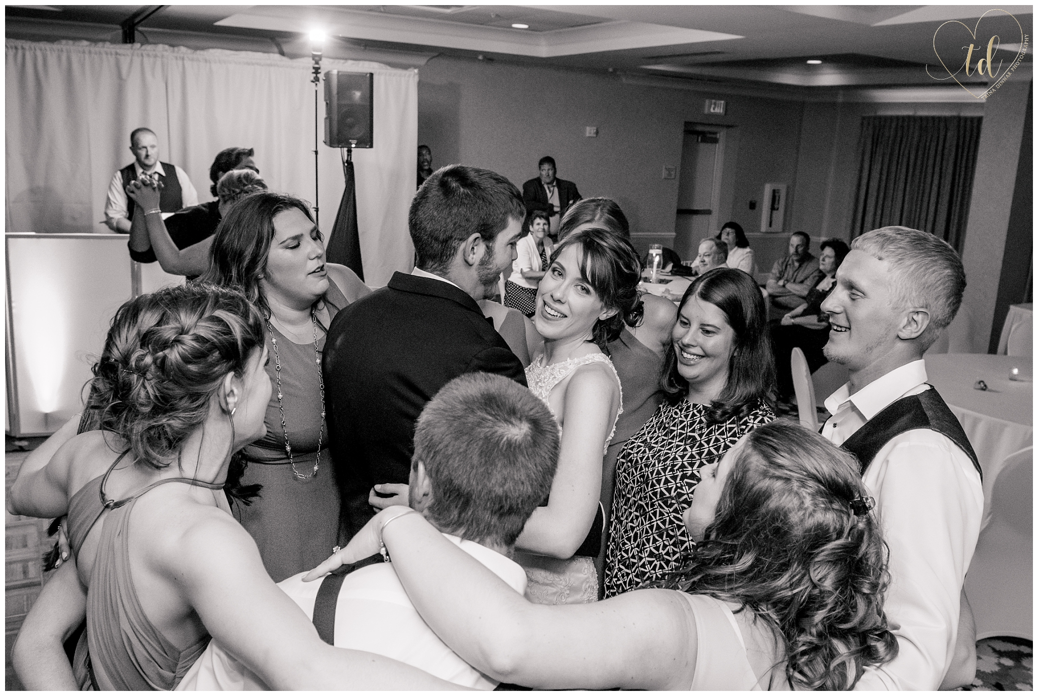 Group dancing at a wedding photographed by photographers in Maine.